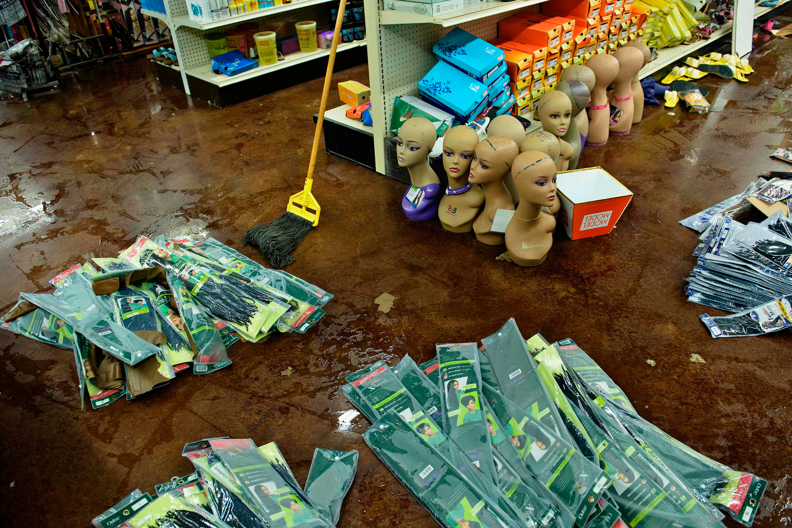 Damaged products are seen at Jasmine's Beauty Supply following the floods in Baton Rouge, La., on Aug. 16, 2016.
