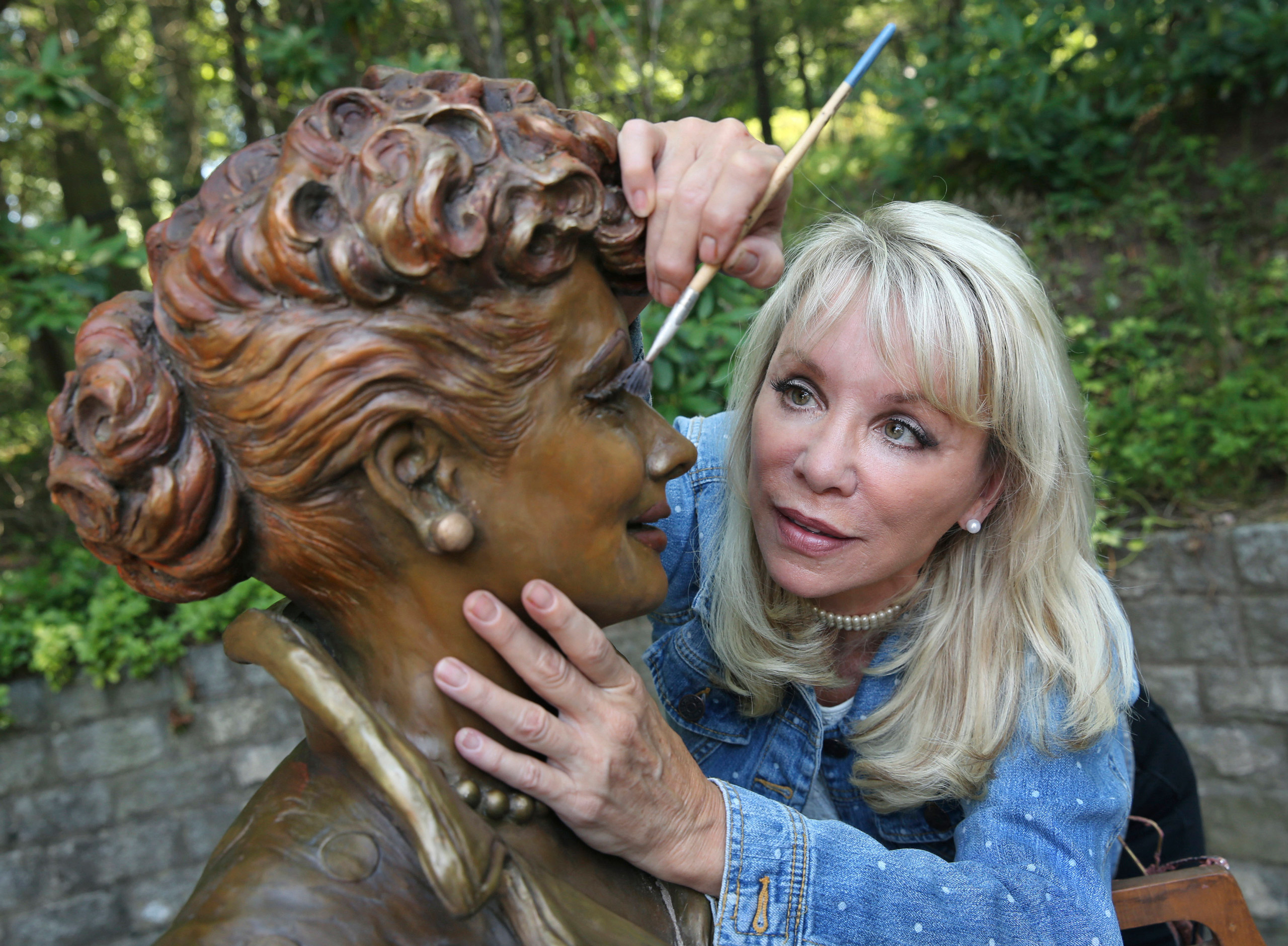 Artist Carolyn Palmer prepares to apply a cold patina to her bronze statue of Lucille Ball in Saddle River, N.J., on July 20, 2016.