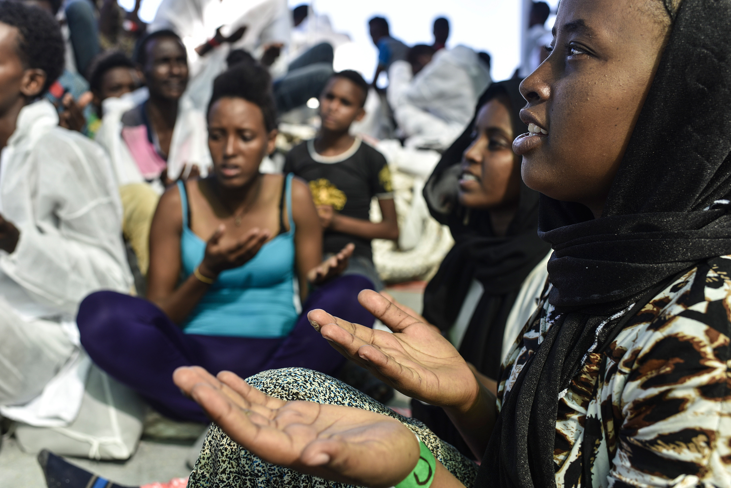 Eritrean Orthodox Christian women sing and give thanks on the MV Aquarius, Aug. 21, 2016.