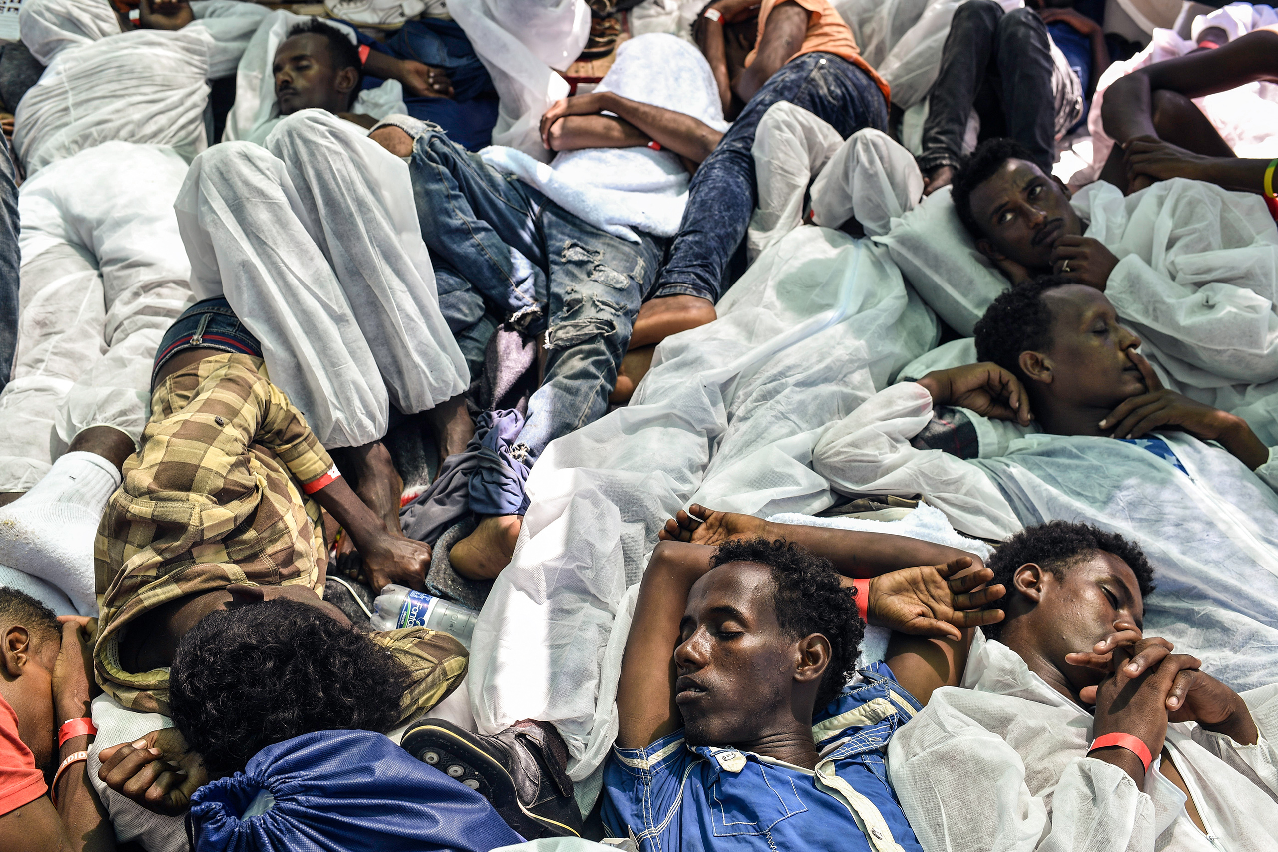 A group of men sleep on MV Aquarius ship after being rescued by search-and-rescue teams jointly operated by Médecins Sans Frontières and SOS Méditerranée, Aug. 21, 2016.