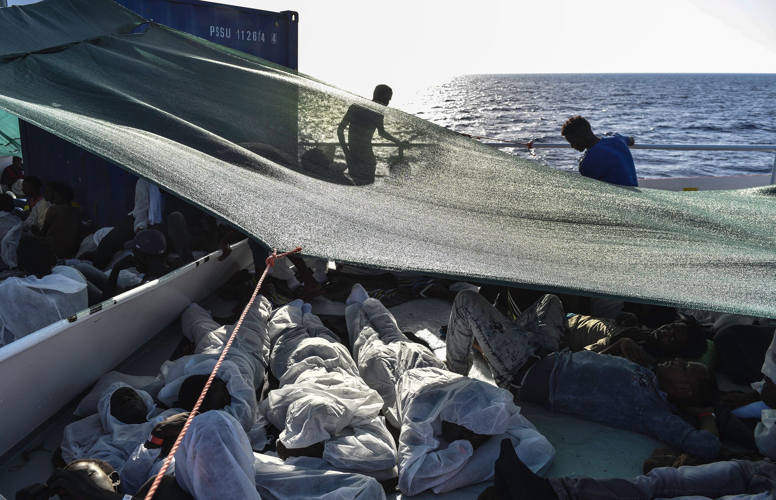 Migrants settle on the deck of the MV Aquarius ship on the eve of the rescue, Aug. 21, 2016.