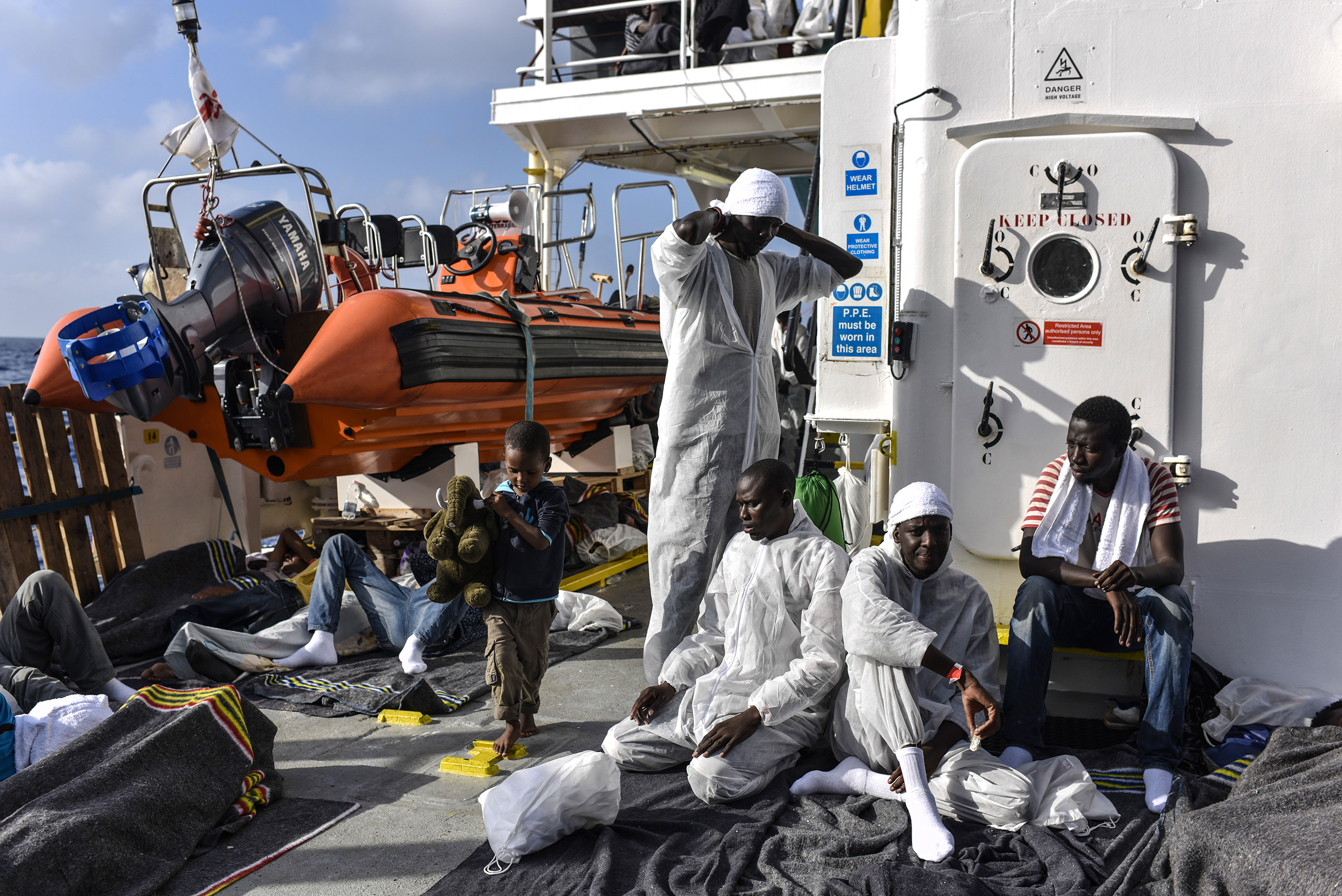 Muslim migrants preparing for prayer on the deck of the MV Aquarius ship, Aug. 22, 2016.