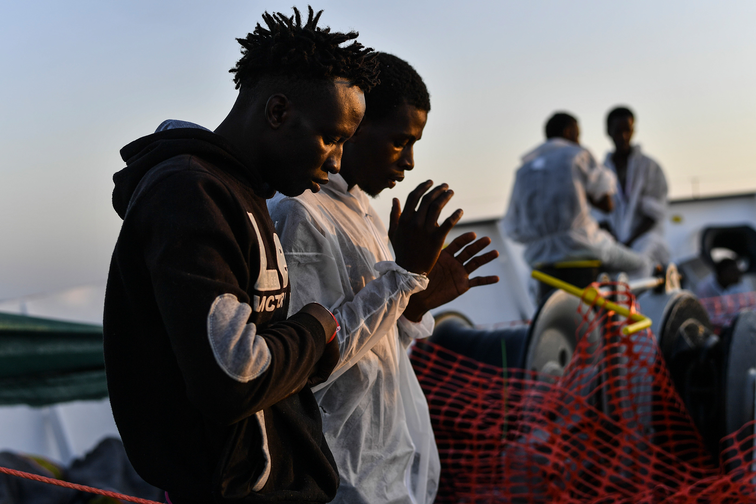 Muslim migrants in prayer on the deck of the MV Aquarius, Aug. 22, 2016.