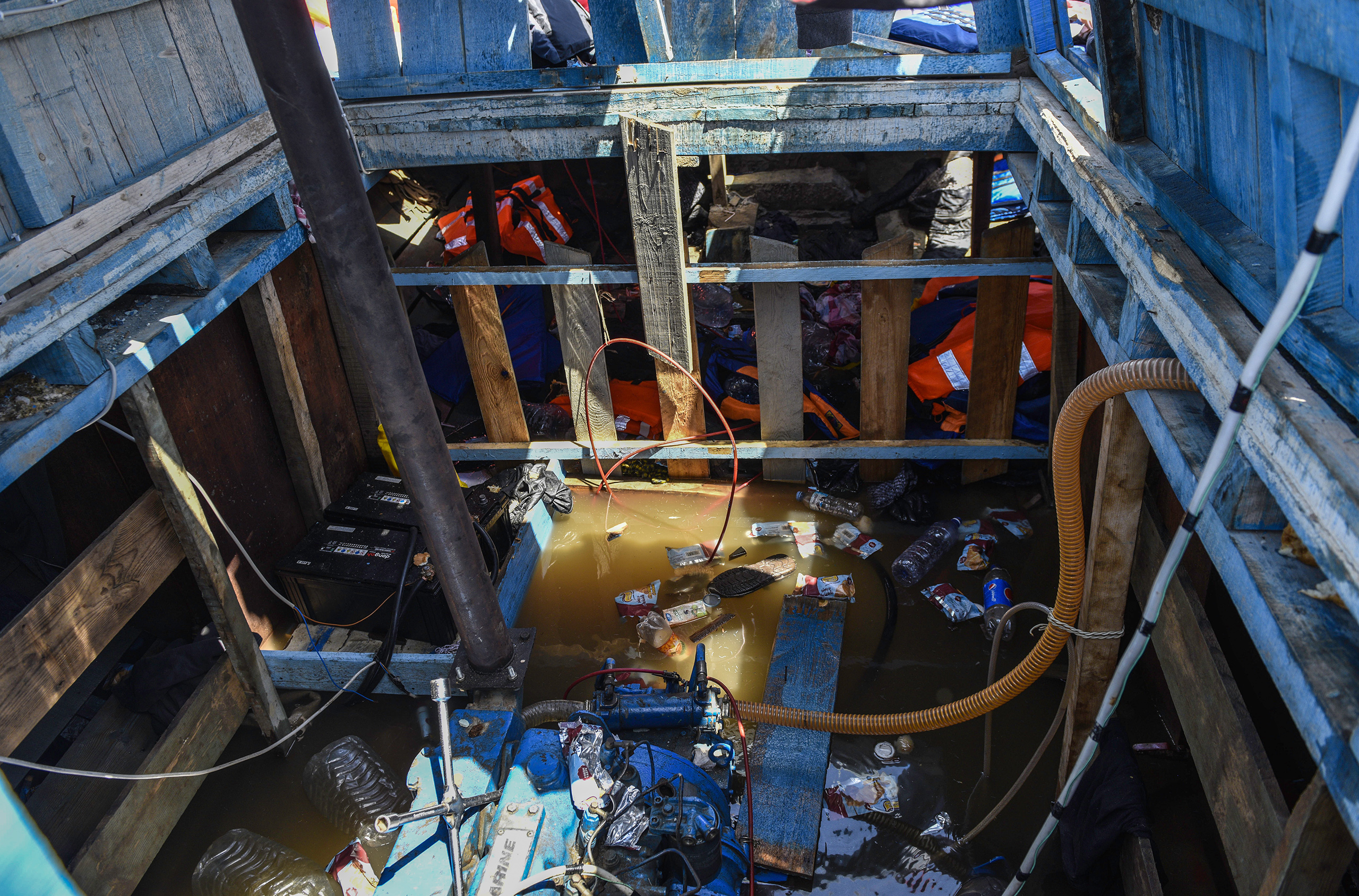 Discarded life jackets, clothing and trash in the empty leaking vessel after the rescue in the Mediterranean, Aug. 21, 2016.