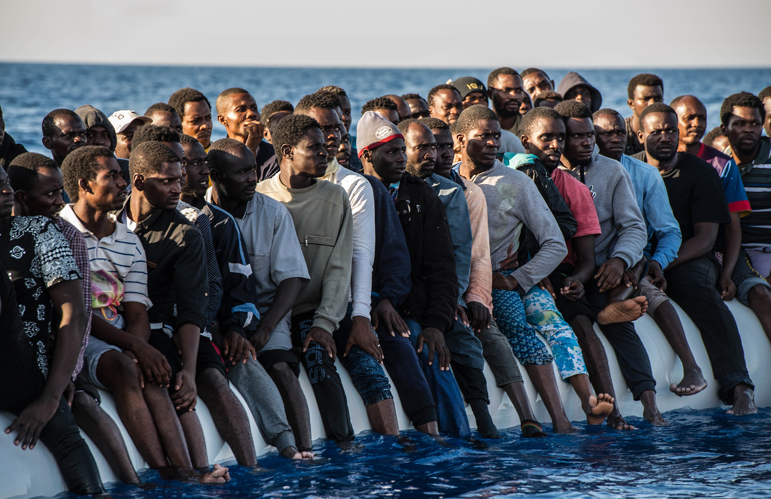 Migrants on the rubber boat in Mediterranean are rescued, Aug. 20, 2016.