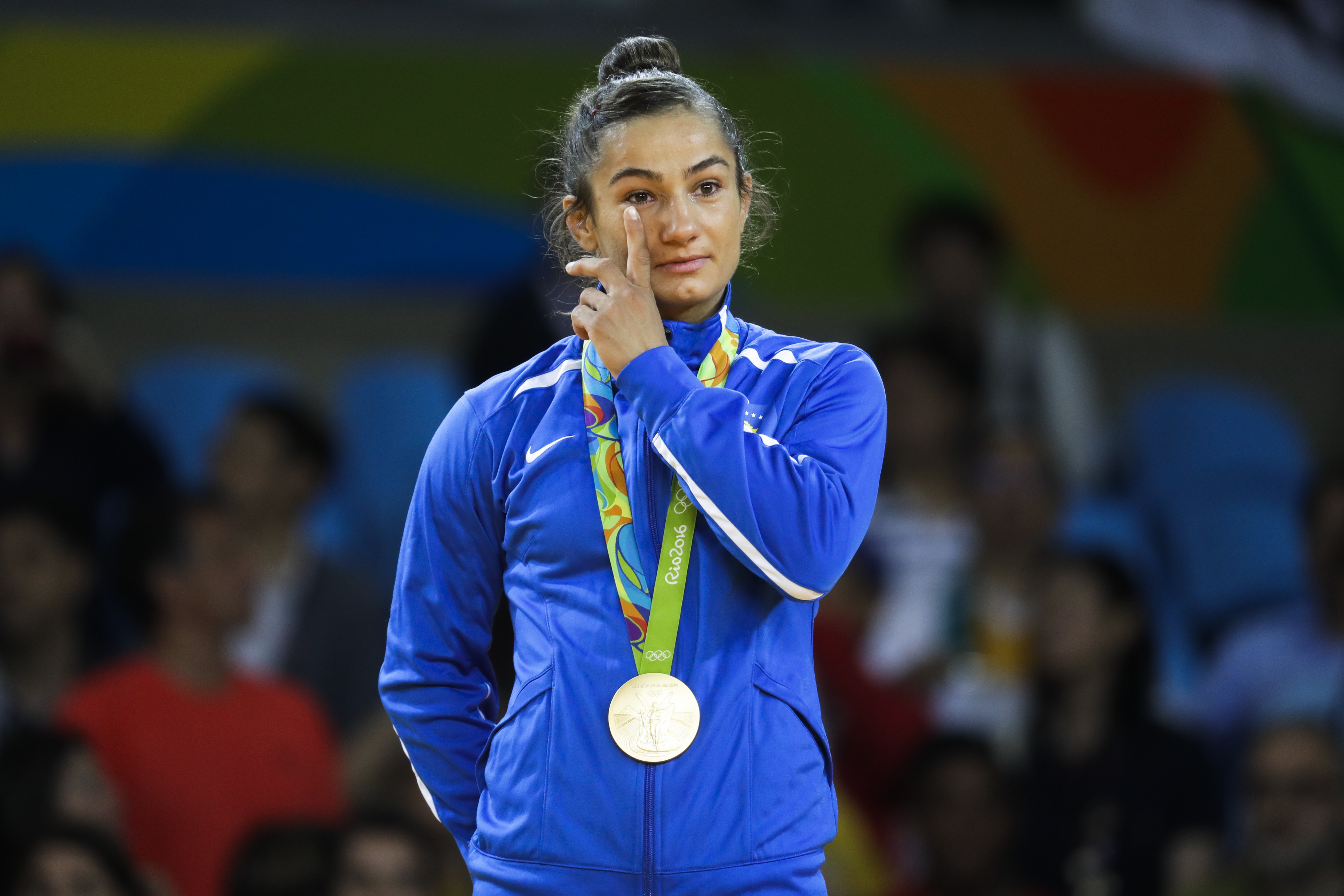 Kosovo's Majlinda Kelmendi receives the gold medal after winning the women's 52-kg judo competition at the 2016 Summer Olympics in Rio de Janeiro, Brazil, Sunday, Aug. 7, 2016.