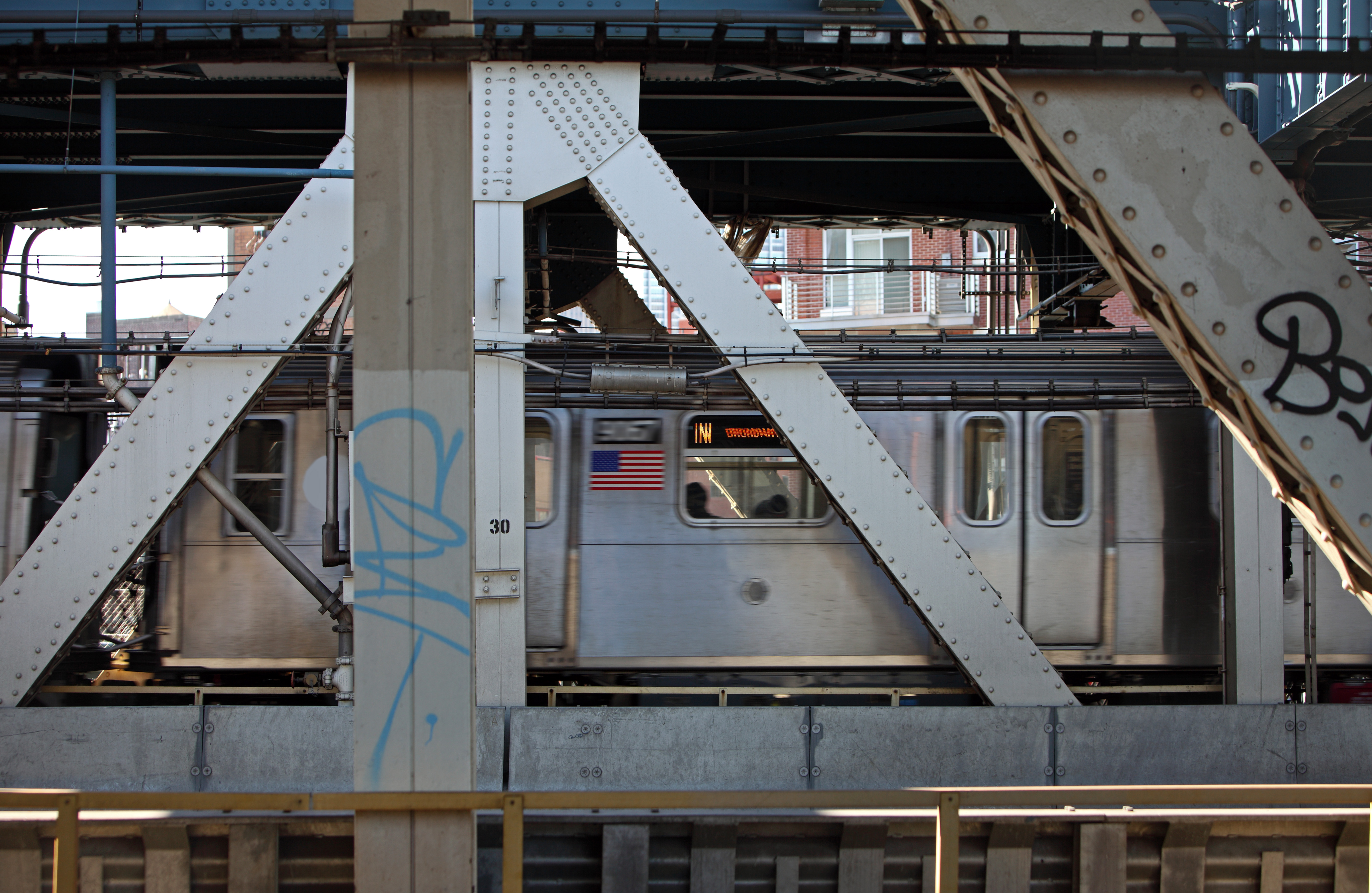 Most subway cars pass over the Manhattan Bridge, as pictured here, without cricket incidents.