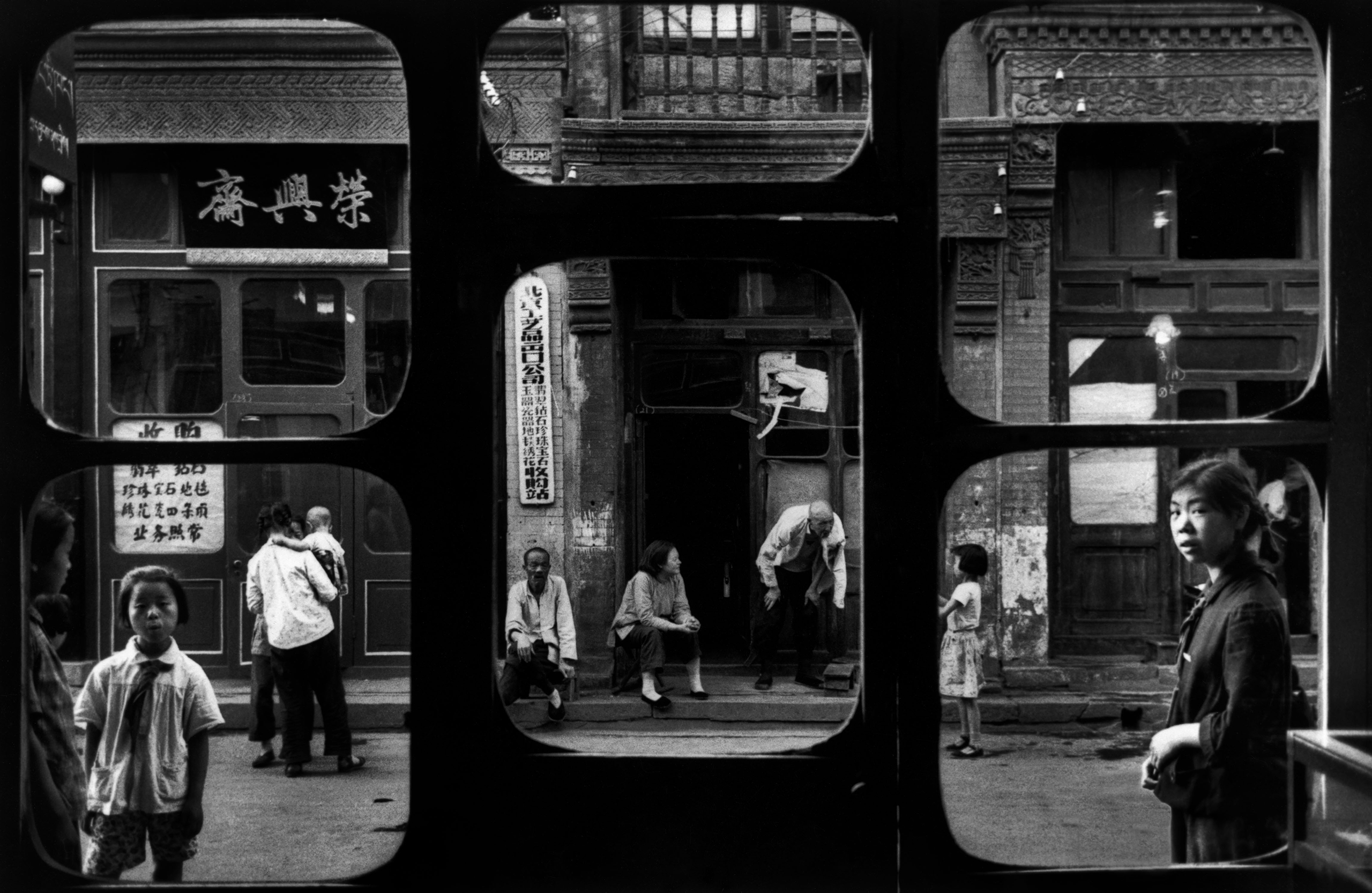 A street as seen from inside an antique dealer's shop in Beijing, 1965.