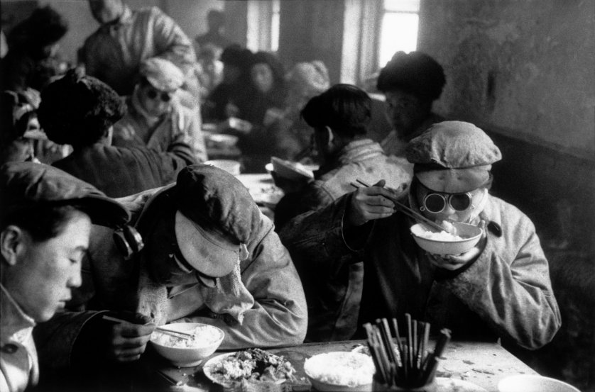 Canteen engineers have lunch while keeping their protective glasses on in a large steel mill built by the Soviets in Anshan, Liaoning province, China, 1957. As in the rest of China, it is hard to distinguish the engineers from the factory workers.