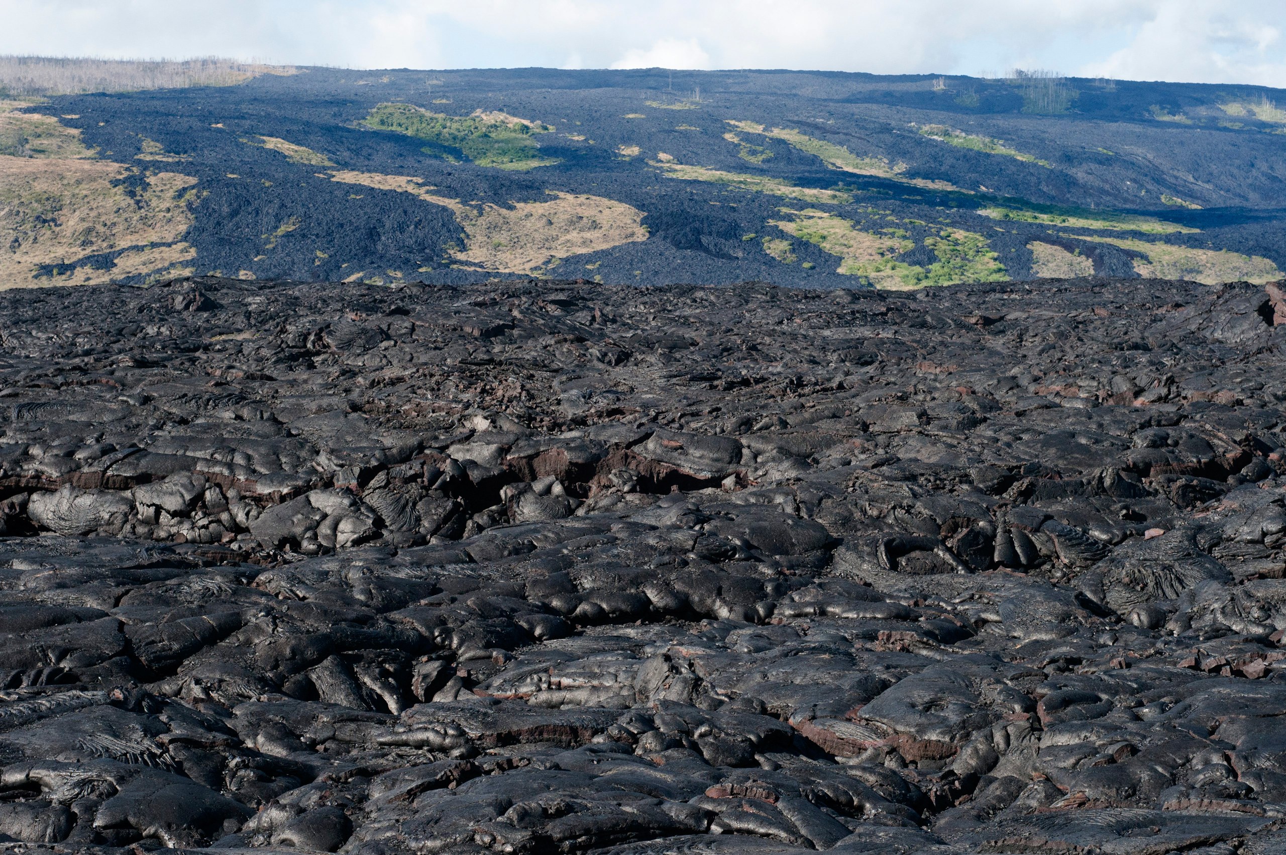 Black lava mountains near the coast and highway Chain of Crater Road on Big Island, Hawaii.