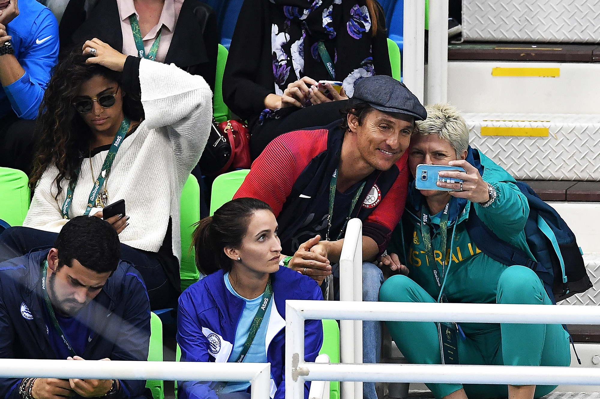 Matthew McConaughey takes a selfie with a guest during the swimming semifinals and finals on Day 5 of the Rio 2016 Olympic Games, on Aug. 9, 2016 in Rio de Janeiro, Brazil.