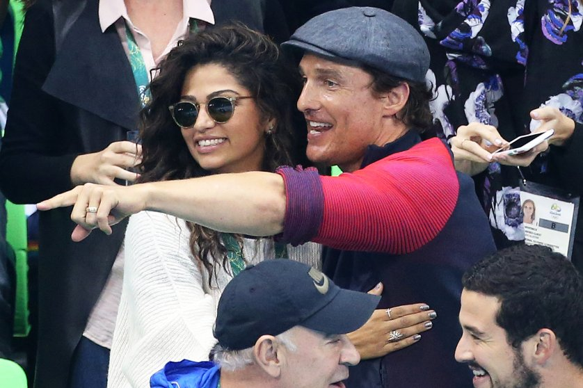 Matthew McConaughey and Camila Alves attend the swimming finals on day 5 of the Rio 2016 Olympic Games, on Aug. 10, 2016 in Rio de Janeiro, Brazil.