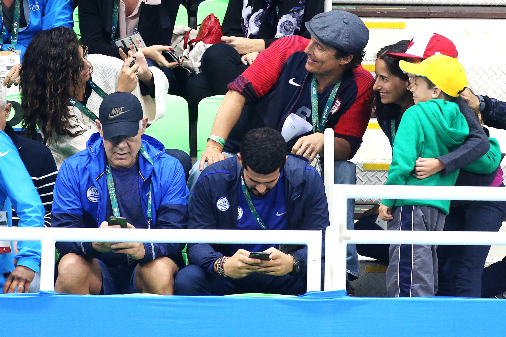 Camila Alves takes a picture of Matthew McConaughey with fans during the swimming finals on day 5 of the Rio 2016 Olympic Games, on Aug. 10, 2016 in Rio de Janeiro, Brazil.