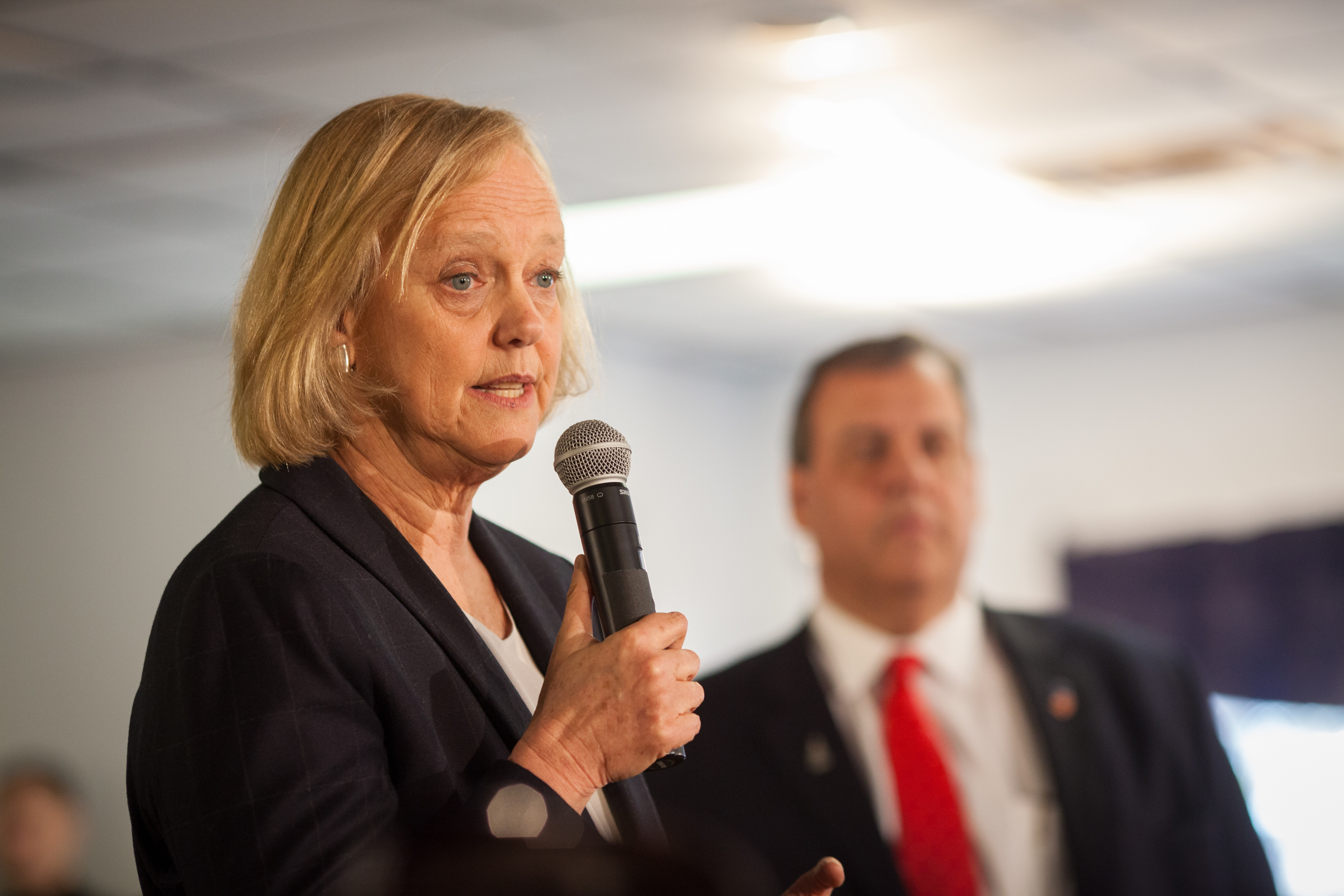 Hewlett Packard CEO Meg Whitman introduces New Jersey Gov. Chris Christie, then a Republican presidential hopeful,  at the Epping American Legion on Feb. 2, 2016 in Epping, New Hampshire. She announced her support for Democratic nominee Hillary Clinton on Aug. 2.