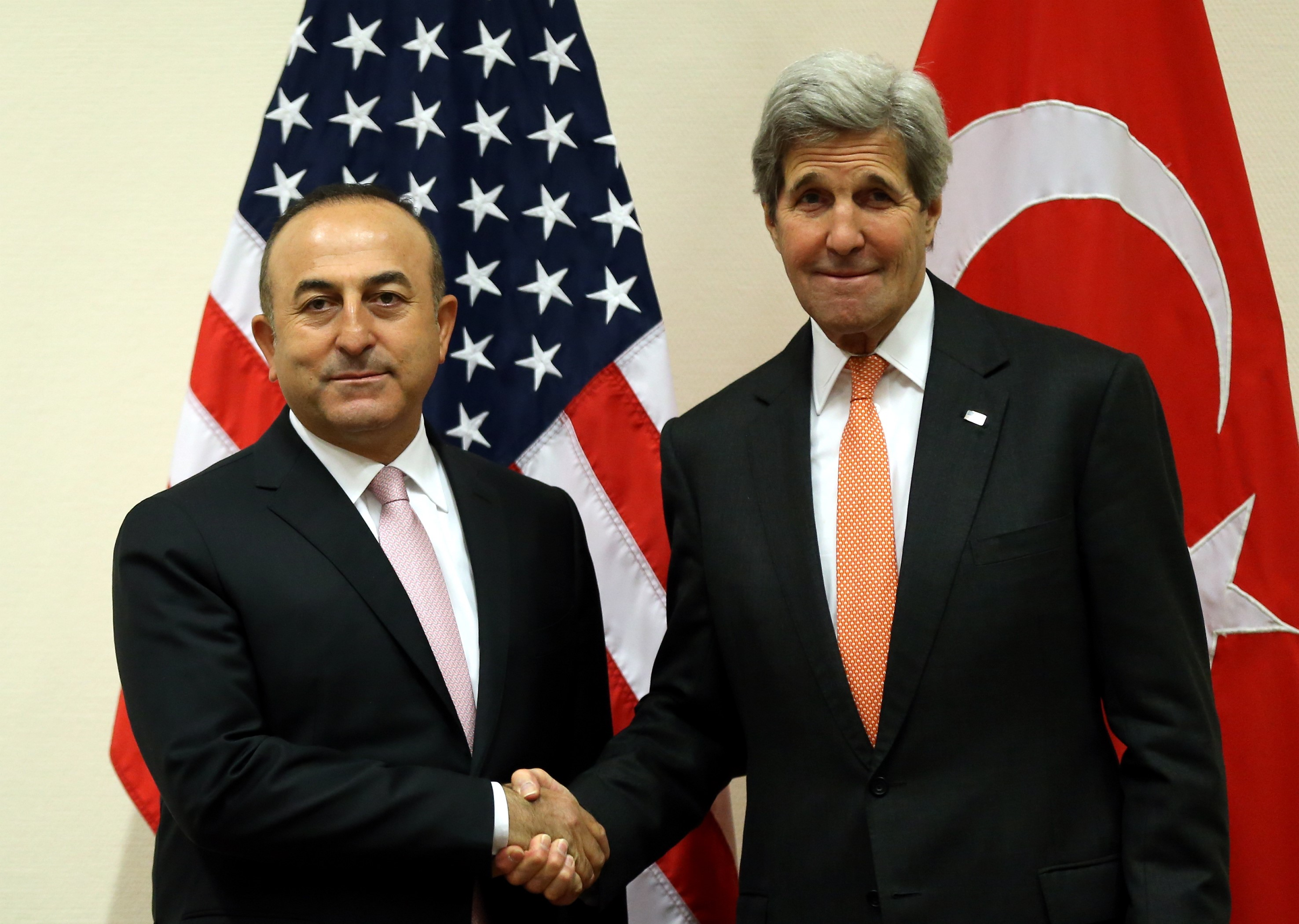 Turkish Foreign Affairs Minister Mevlut Cavusoglu (left) and US Secretary of State John Kerry (right) shake hands during the NATO Foreign ministers meeting at the NATO headquarters in Brussels, Belgium on May 20, 2016.