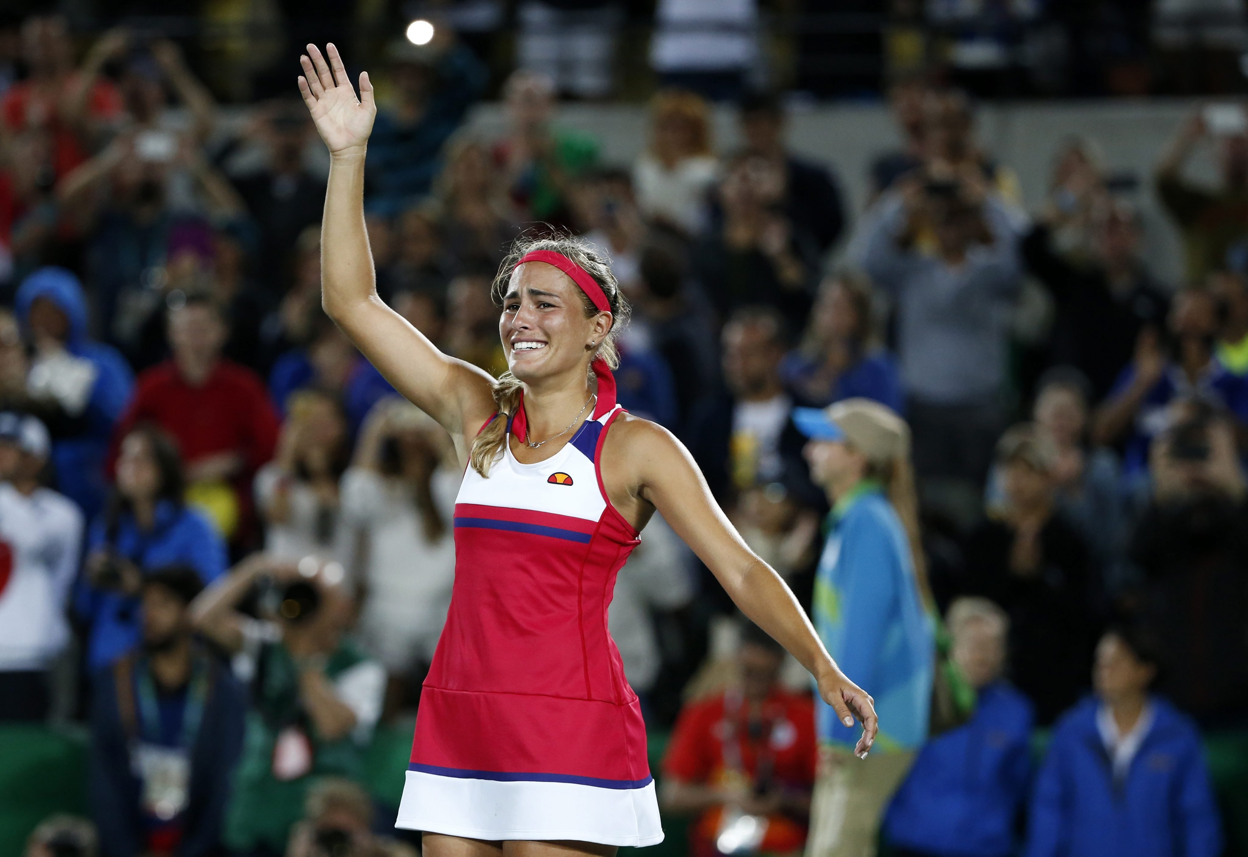 Monica Puig of Puerto Rico celebrates defeating Angelique Kerber of Germany during the women's Singles Gold medal match of the Rio 2016 Olympic Games Tennis events at the Olympic Tennis Centre in the Olympic Park in Rio de Janeiro on Aug. 13, 2016.