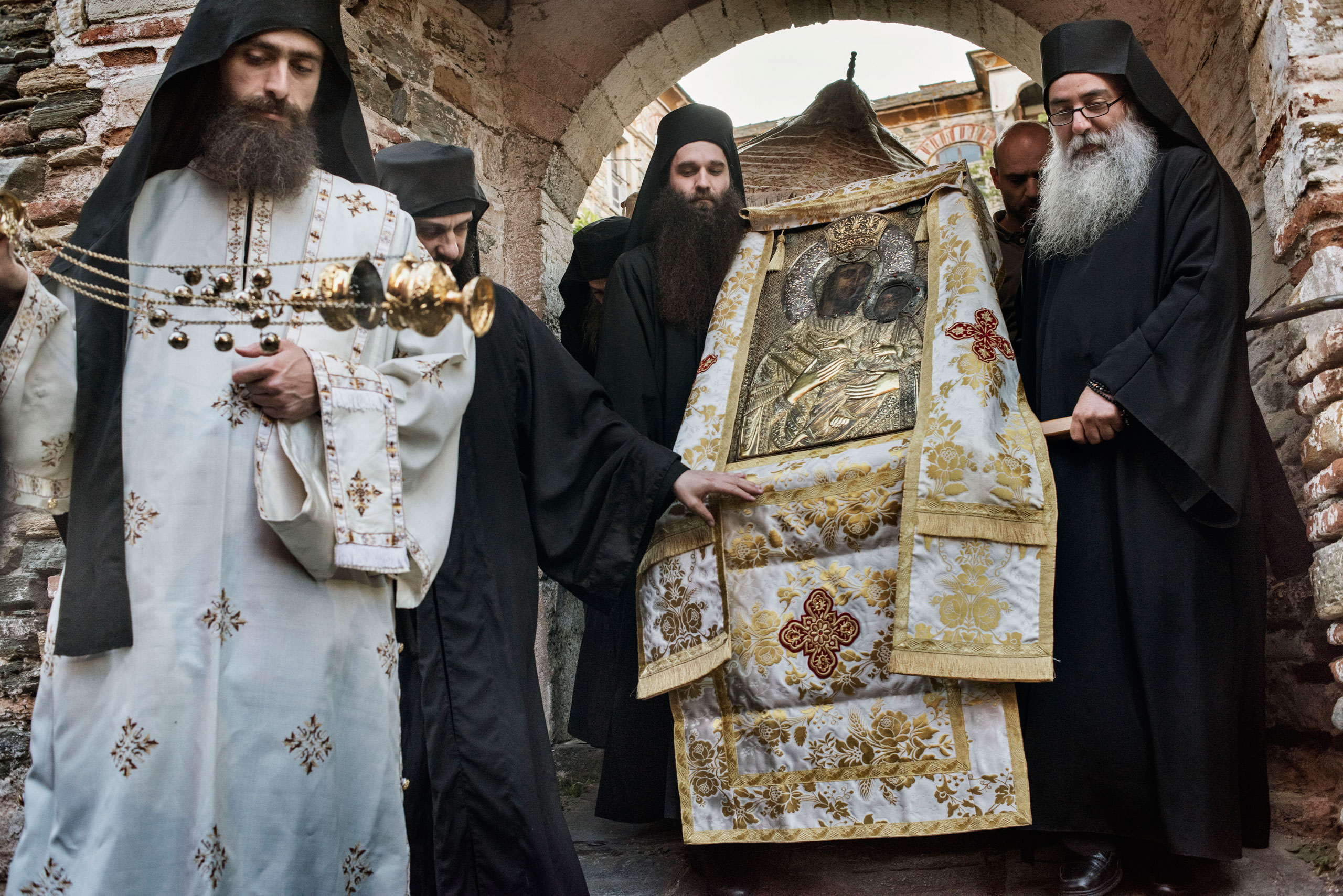 Orthodox Christian monks carry an icon of the Virgin and Child inside the Greek Monastery of Vatopedi, one of the oldest and largest of the 20 monasteries on Mount Athos, a self-governing community of Orthodox Christian monks in northern Greece, May 29, 2016.