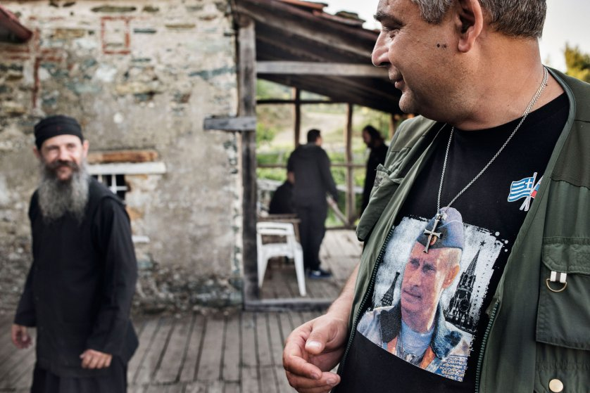 Andrei Borisov, a Ukrainian businessman, smiles at a Greek Orthodox monk at a monastic hermitage on Mount Athos, a peninsula in northern Greece that many Orthodox believers consider to be one of the holiest places in the world, on May 28, 2016. Borisov earns his living by organizing tours to Mount Athos for wealthy pilgrims, primarily from Russia and Ukraine. T-shirts like the one he is wearing, with a depiction of Russian President Vladimir Putin, are sometimes sold to visiting pilgrims at gift shops on Mount Athos.