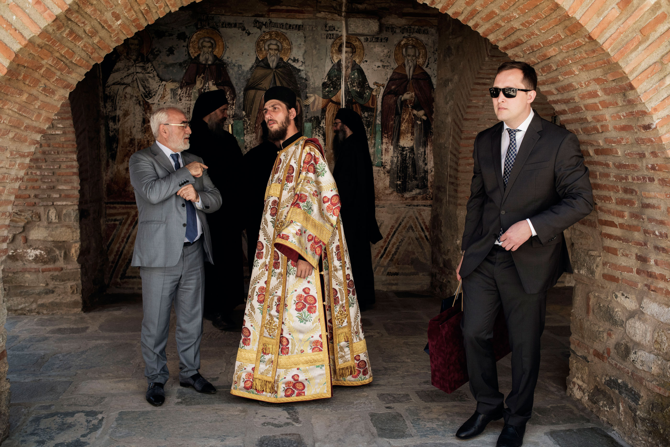 Monks and laymen stand outside the Protaton, the oldest church on Mount Athos, a self-governing monastic community in northern Greece, May 28, 2016.