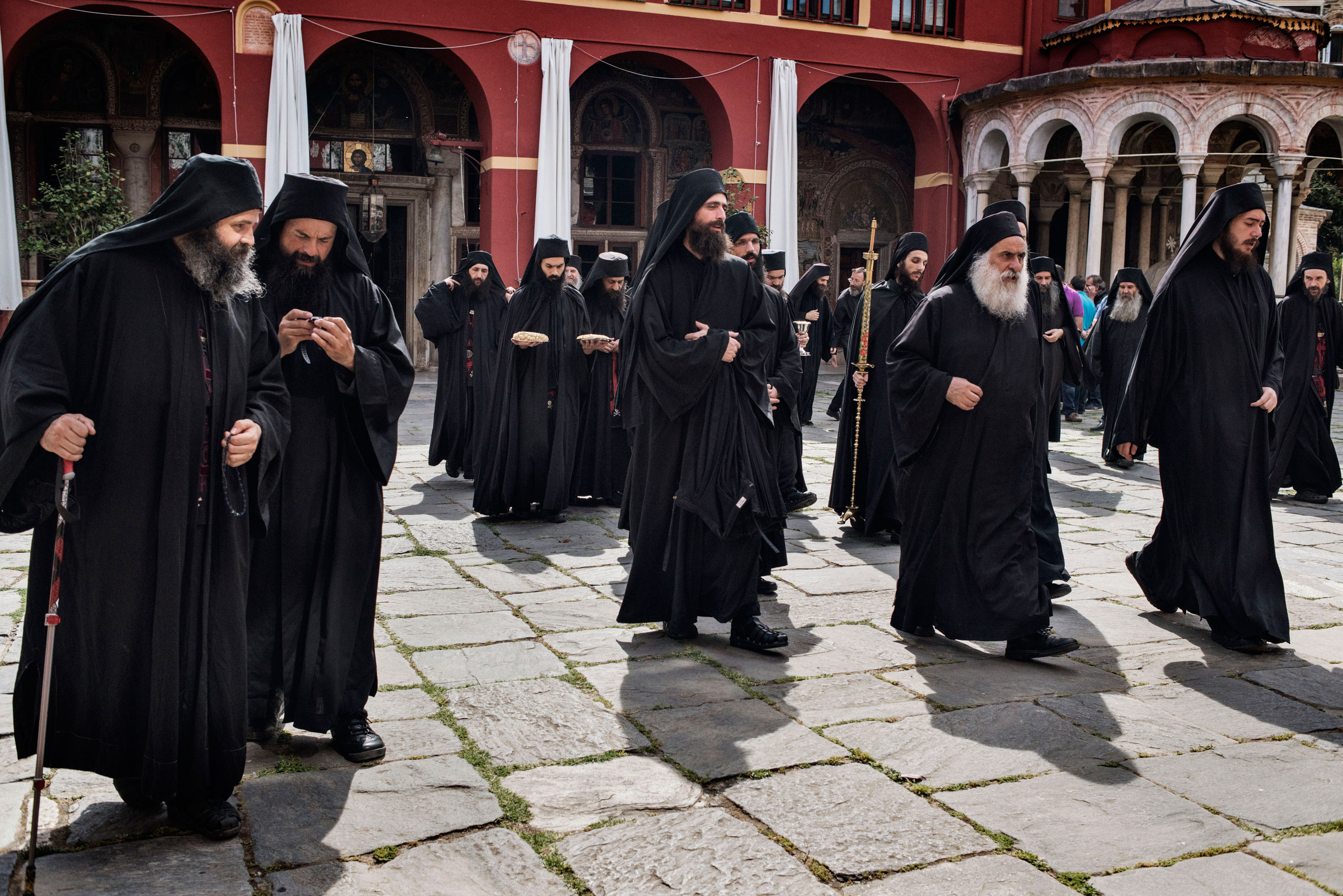Orthodox monks walk from the main church to the refectory, or dining hall, at the Greek Monastery of Vatopedi, on Mount Athos, Greece, May 29, 2016.