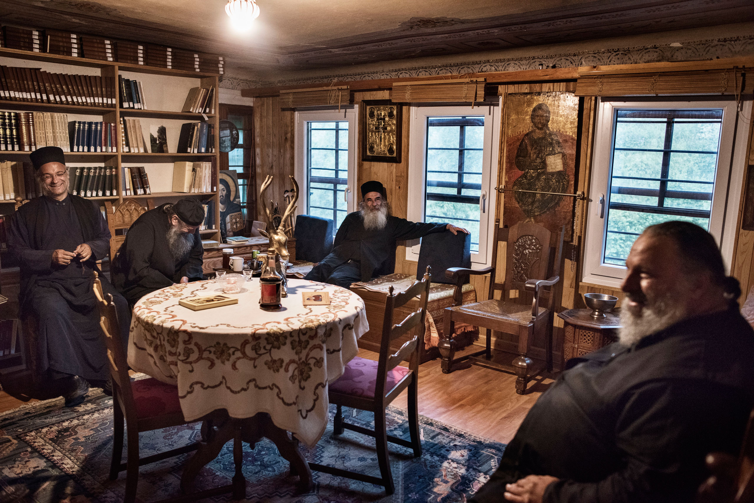 Orthodox Christian monks share a drink of sweet wine after the evening prayers at a hermitage run by Father Makarios (center), a Greek Orthodox priest in Mount Athos, Greece, May 26,  2016