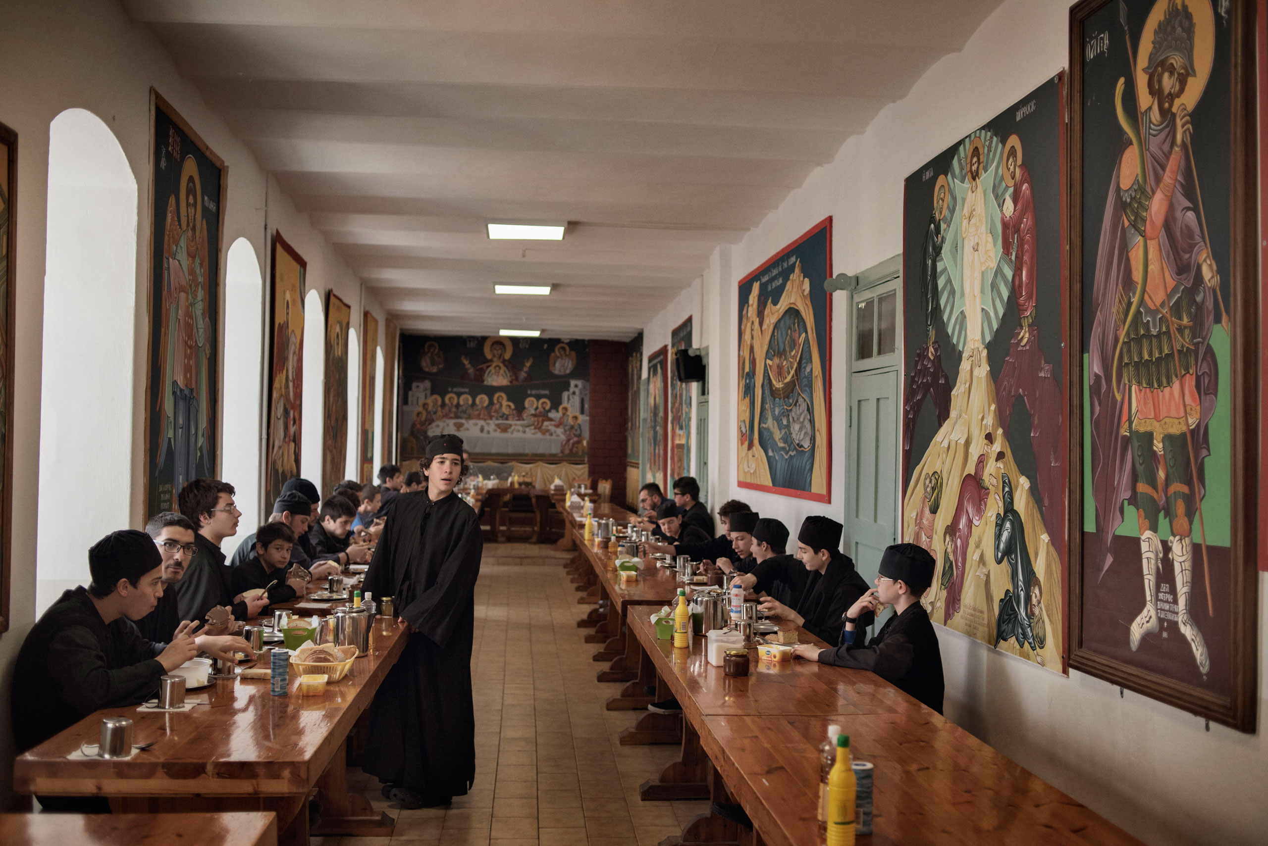 Students at the Athonias Ecclesiastical Academy, an all-boys boarding school in the Orthodox Christian monastic state of Mount Athos, in northern Greece, have breakfast at the school's communal dining hall, May 30, 2016.