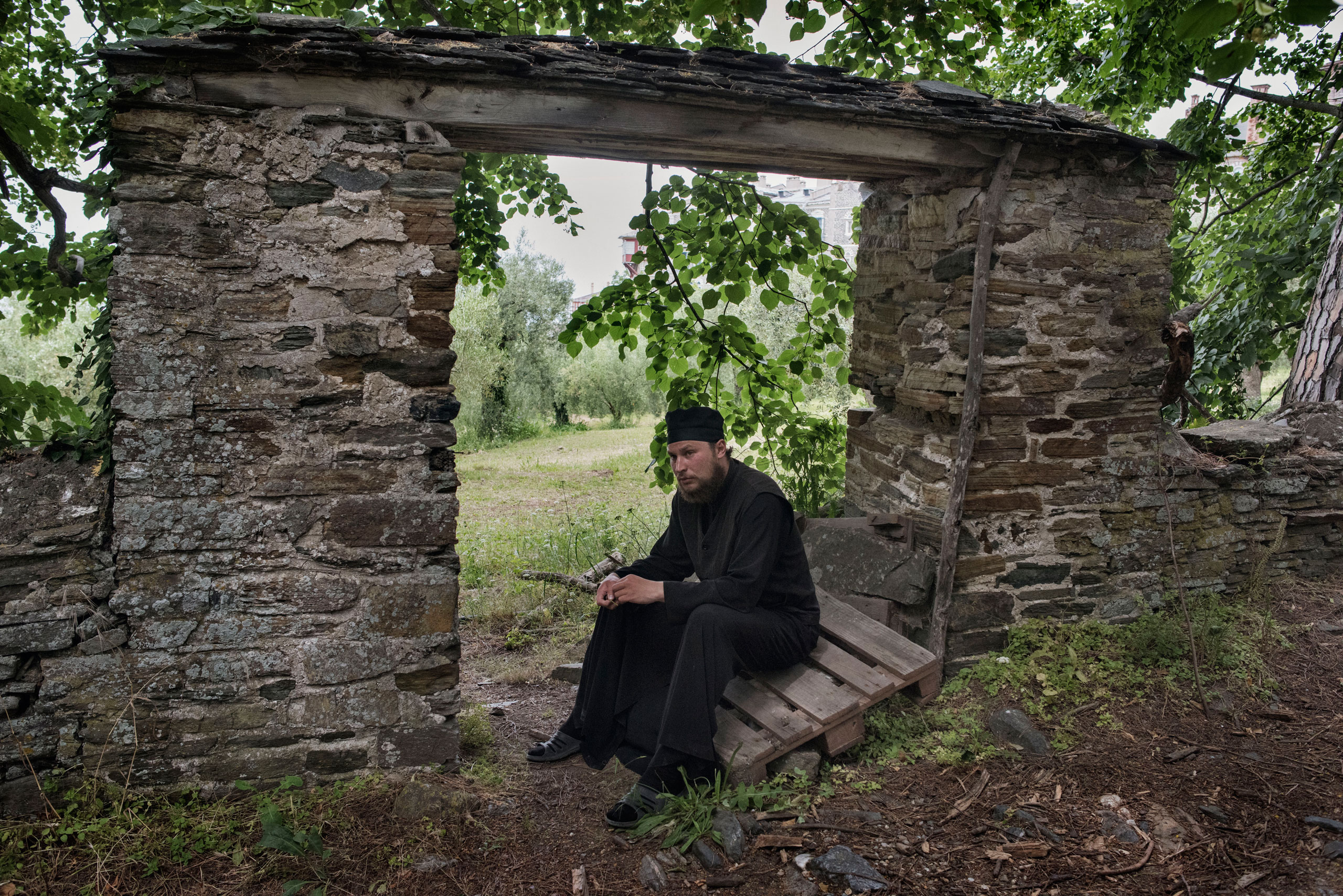 Father Pavel, a 32-year-old Orthodox monk from the Russian city of Nizhny Novgorod, rests on the grounds of the Greek monastery of Vatopedi on Mount Athos, a self-governing community of Orthodox Christian monks in northern Greece, May 29, 2016. Having moved to Mount Athos from Russia four years ago, Father Pavel has not been allowed to join the brotherhood of monks at Vatopedi, the largest Greek monastery on the peninsula, in part because he says Russian monks are  feared  and discriminated against on Mount Athos.
