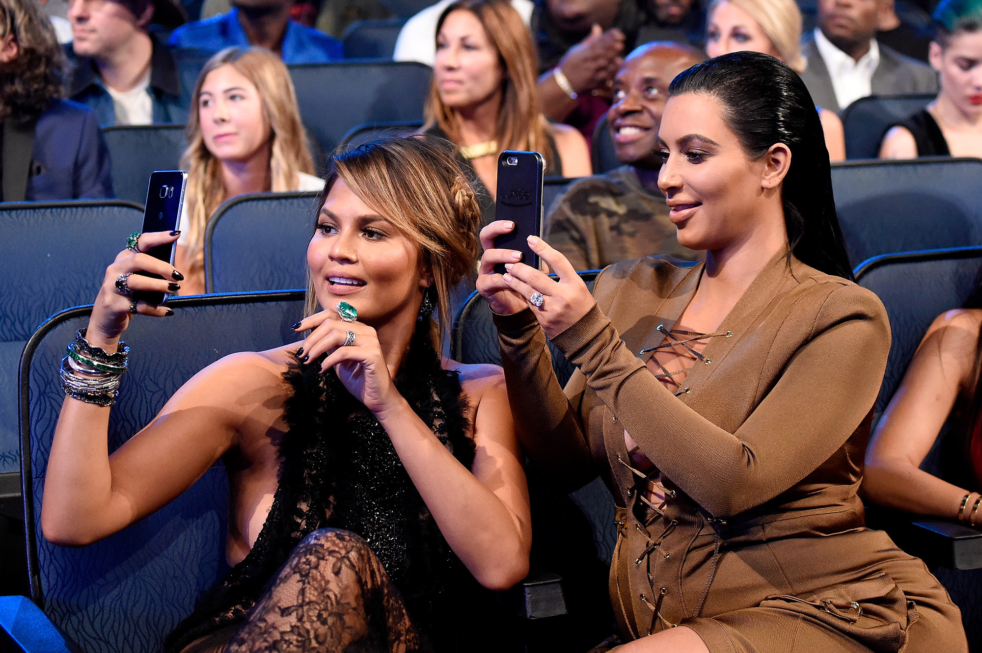 Chrissy Teigen and Kim Kardashian West attend the 2015 MTV Video Music Awards at Microsoft Theater on August 30, 2015 in Los Angeles, California.  (Photo by Kevin Mazur/MTV1415/WireImage)