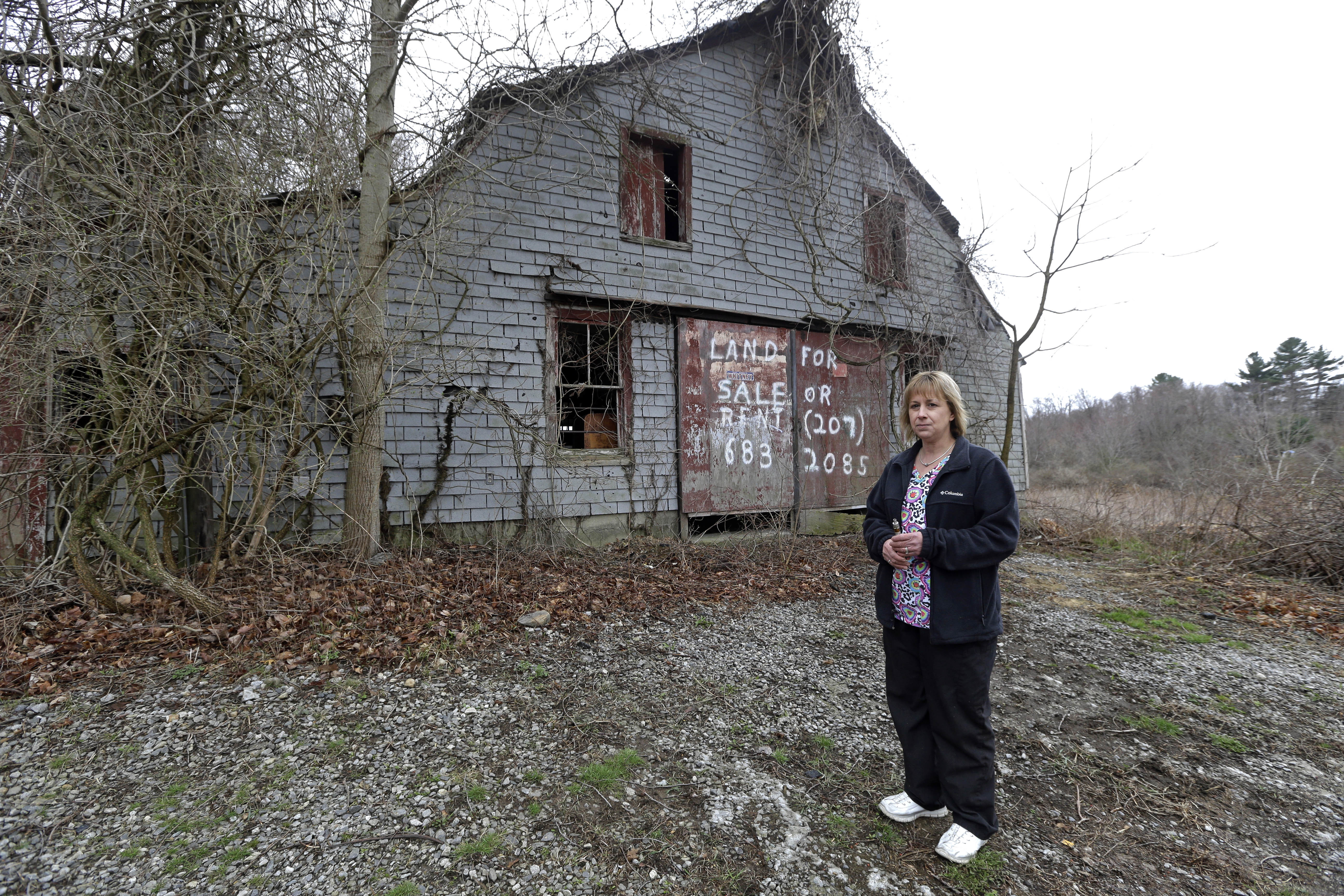 Desiree Moninski stands on the site of a proposed Muslim cemetery in Dudley, Mass on April 12, 2016. Federal prosecutors have opened an investigation into whether civil rights laws were violated by the town of Dudley that has rejected plans for the Muslim cemetery.