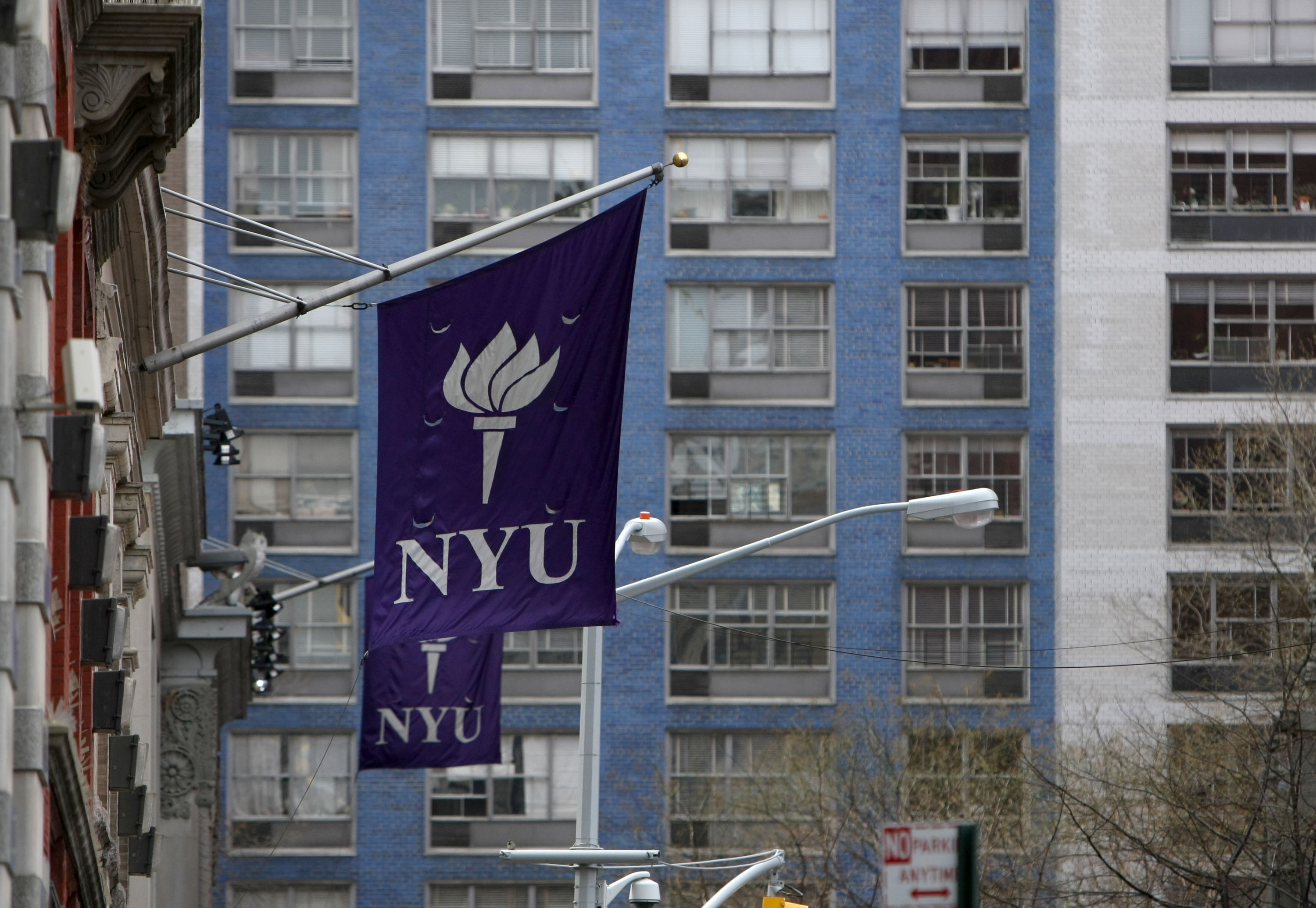 New York University banners hang from a building in New York, U.S., on Monday, April 5, 2010.