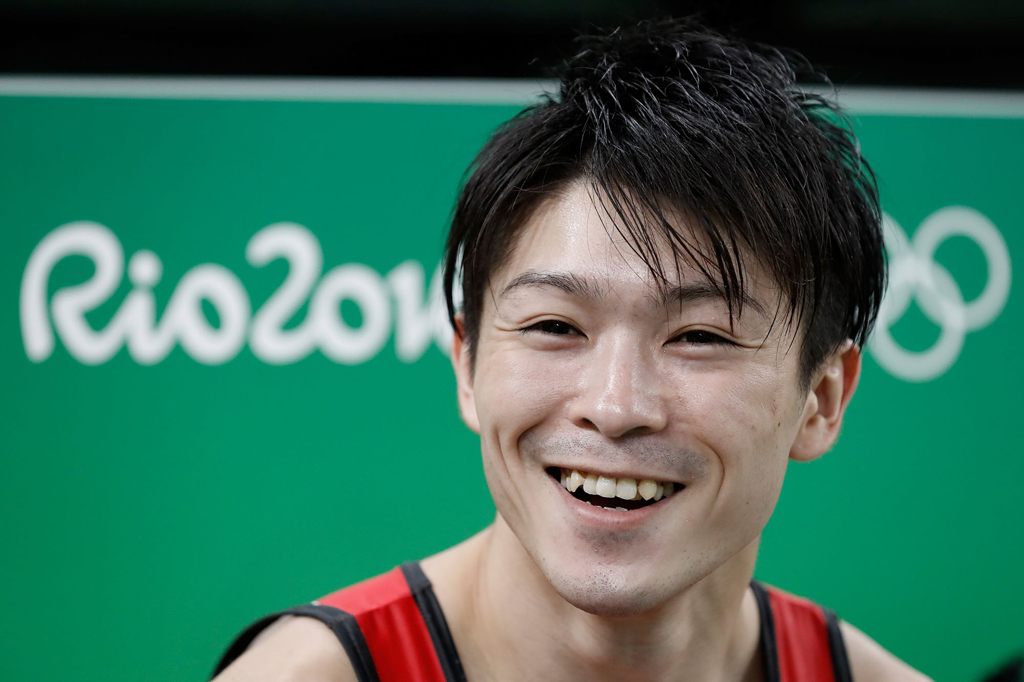 Japan's Kohei Uchimura smiles during a practice session of the men's Artistic gymnastics at the Olympic Arena on August 3, 2016 ahead of the Rio 2016 Olympic Games in Rio de Janeiro. / AFP / Thomas COEX        (Photo credit should read THOMAS COEX/AFP/Getty Images)