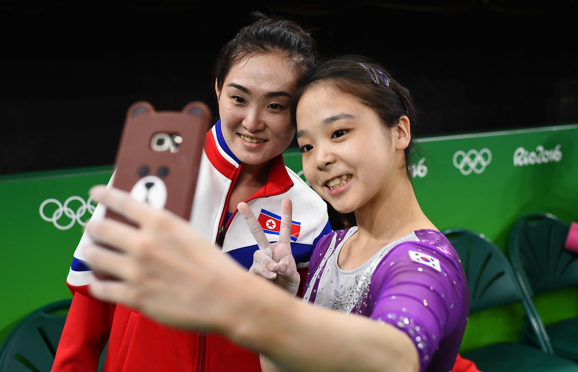Lee Eun-Ju of South Korea, right, takes a selfie with Hong Un Jong of North Korea, left, on Aug. 4, 2016 in Rio de Janeiro, Brazil.