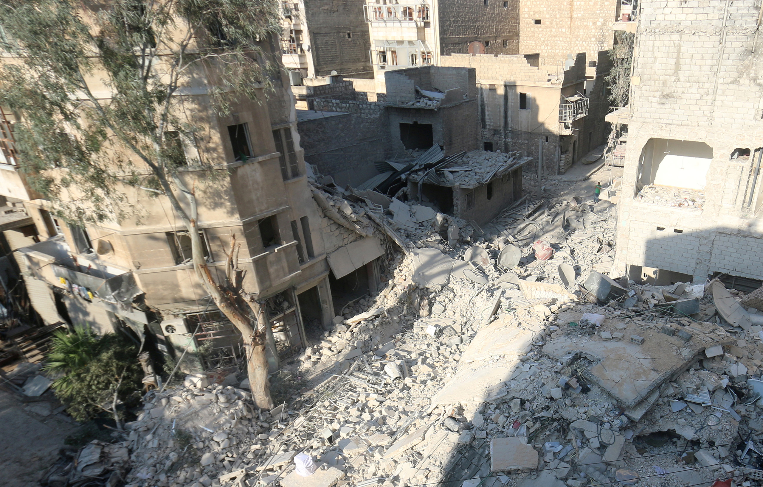 A general view shows the site of the Aug. 17 airstrike where five-year-old Omran Daqneesh and his family were injured in the rebel-held Qaterji neighborhood of Aleppo, Syria, on Aug. 18, 2016. The Daqneesh family lived in the building on the left.