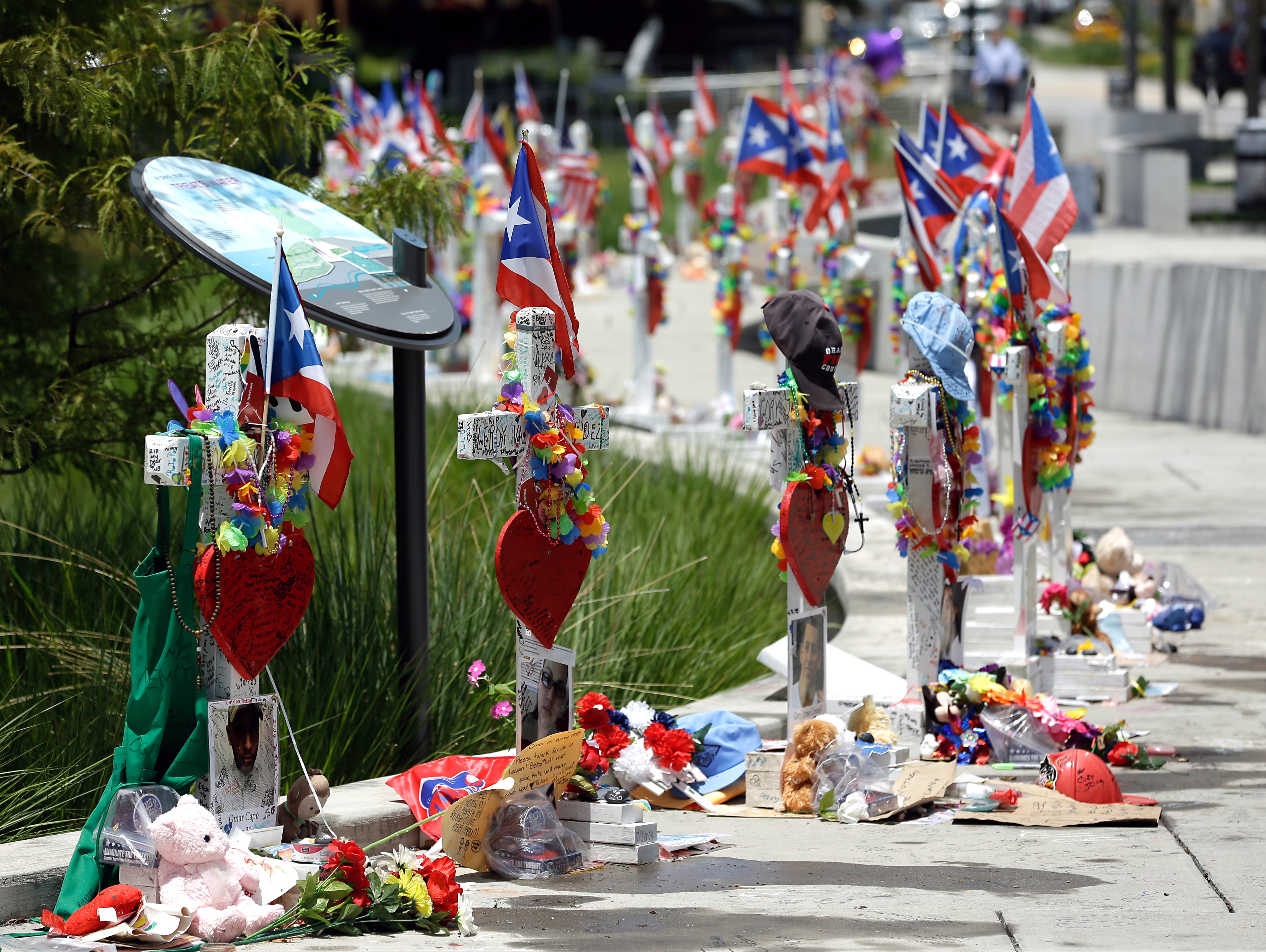 The 49 crosses representing the 49 victims of the Pulse nightclub shooting are seen Monday, July 11, 2016, near the Orlando Regional Medical Center in Orlando, Fla.