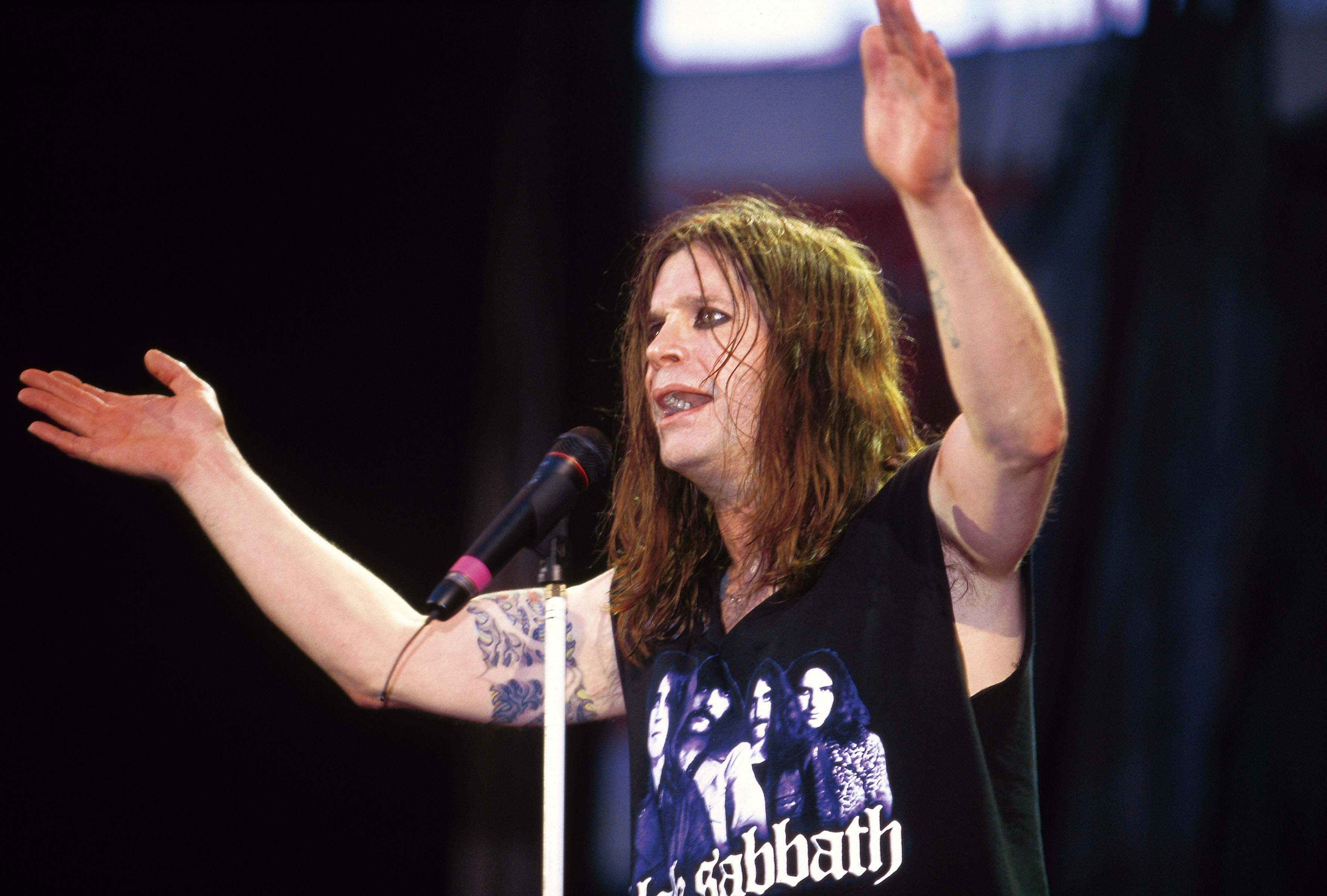 Ozzy Osbourne performing live onstage with Black Sabbath on December 1 at the National Exhibition Center in Birmingham, UK.