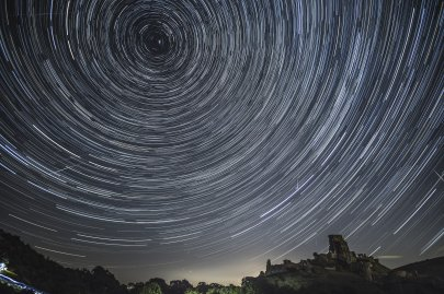 Satellites, planes and comets transit across the night sky under stars that appear to rotate above Corfe Castle, United Kingdom, on Aug. 12, 2016.The Perseids meteor shower occurs every year when the Earth passes through the cloud of debris left by Comet Swift-Tuttle, and appear to radiate from the constellation Perseus in the northeastern sky.