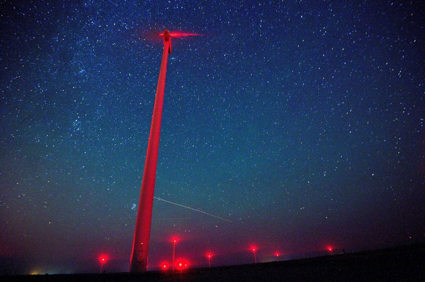 A view of meteors lighting up the night sky above a wind turbine at 'Saint Nikola' wind park near the Kavarna, some 500km from Sofia, Bulgaria, Aug. 12, 2016.