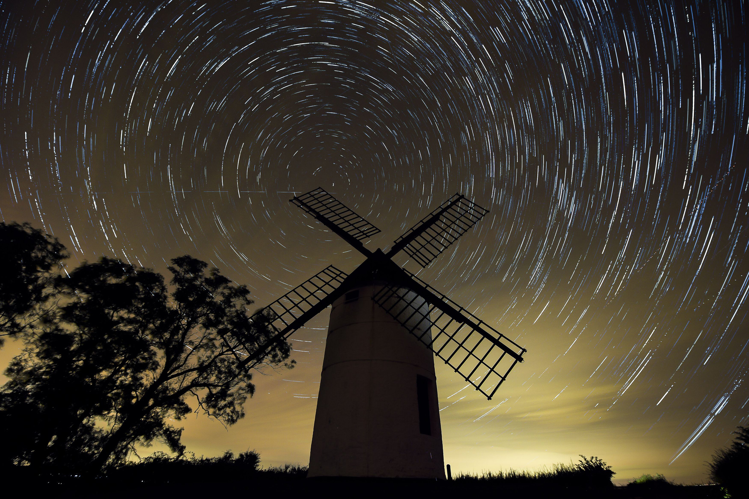A composite image made from 726 photographs taken over three hours, showing the rotation of the earth around Polaris, the North Star, in the night sky over Ashton Windmill, Somerset ahead of the Perseid meteor shower, Aug. 10, 2016.