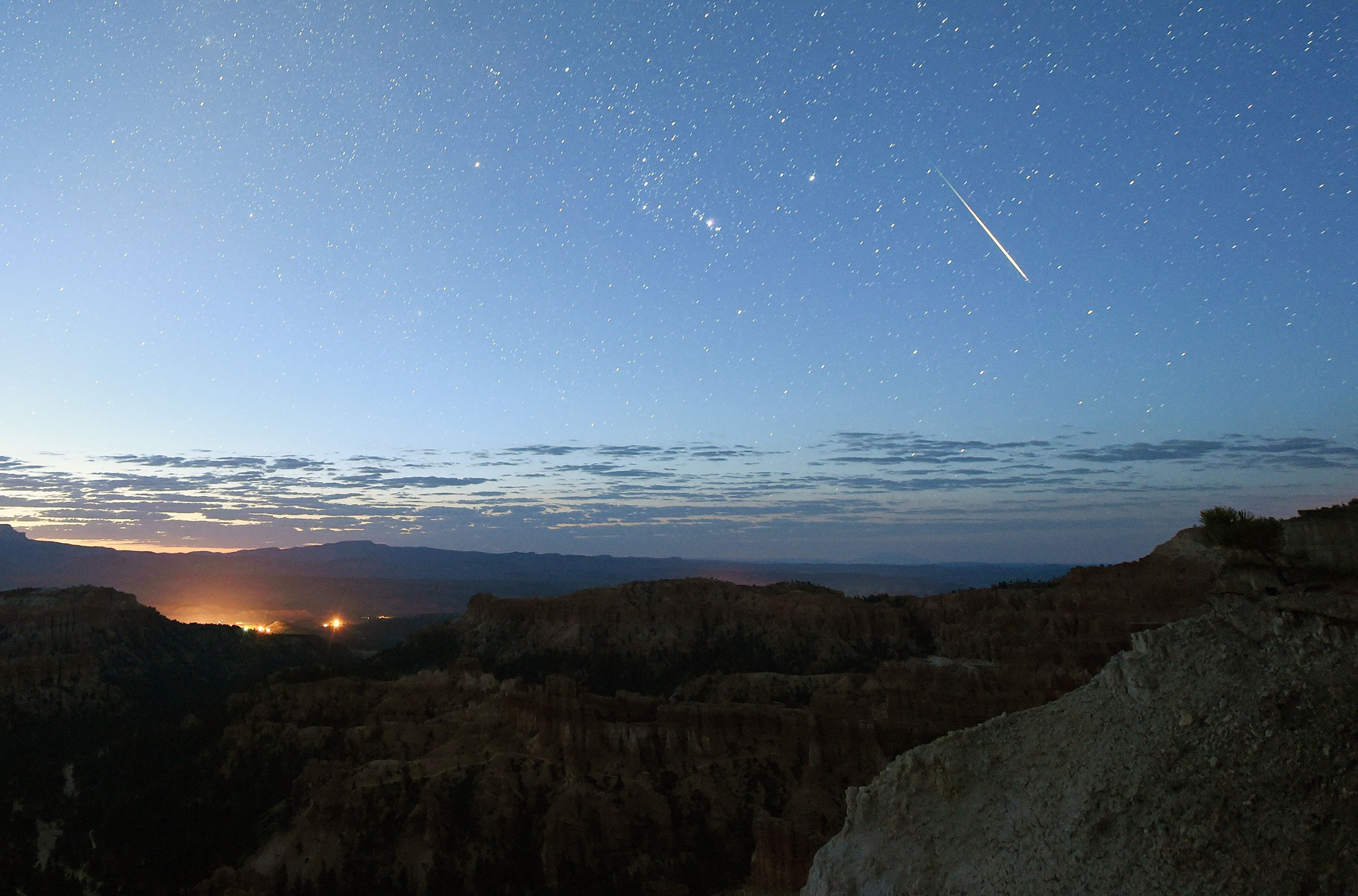 A Perseid meteor streaks across the sky above Inspiration Point in Bryce Canyon National Park, Utah, early on Aug. 12, 2016.