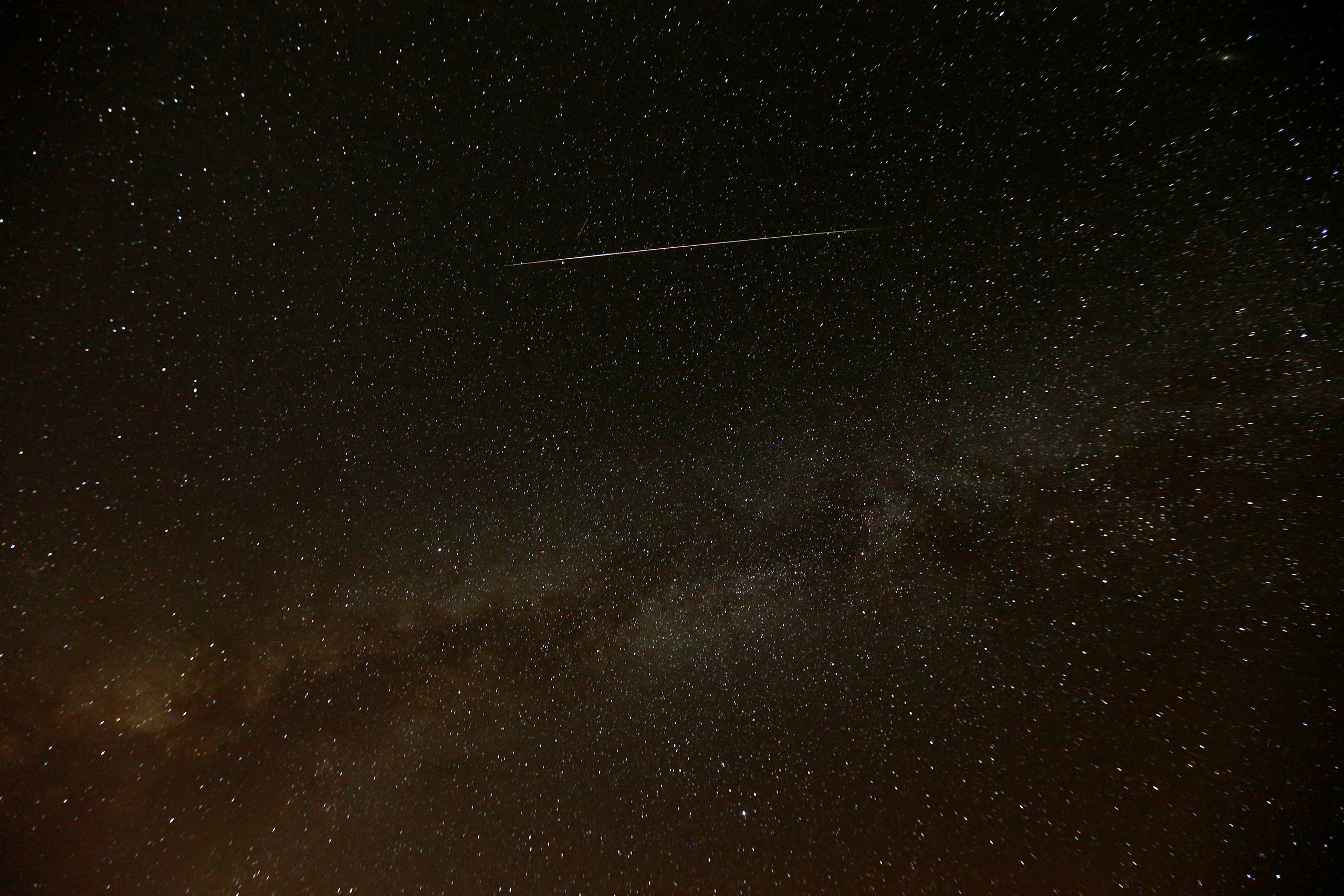 A meteor streaks across the sky in the early morning during the Perseid meteor shower in Ramon Crater near the town of Mitzpe Ramon, southern Israel, Aug. 12, 2016.