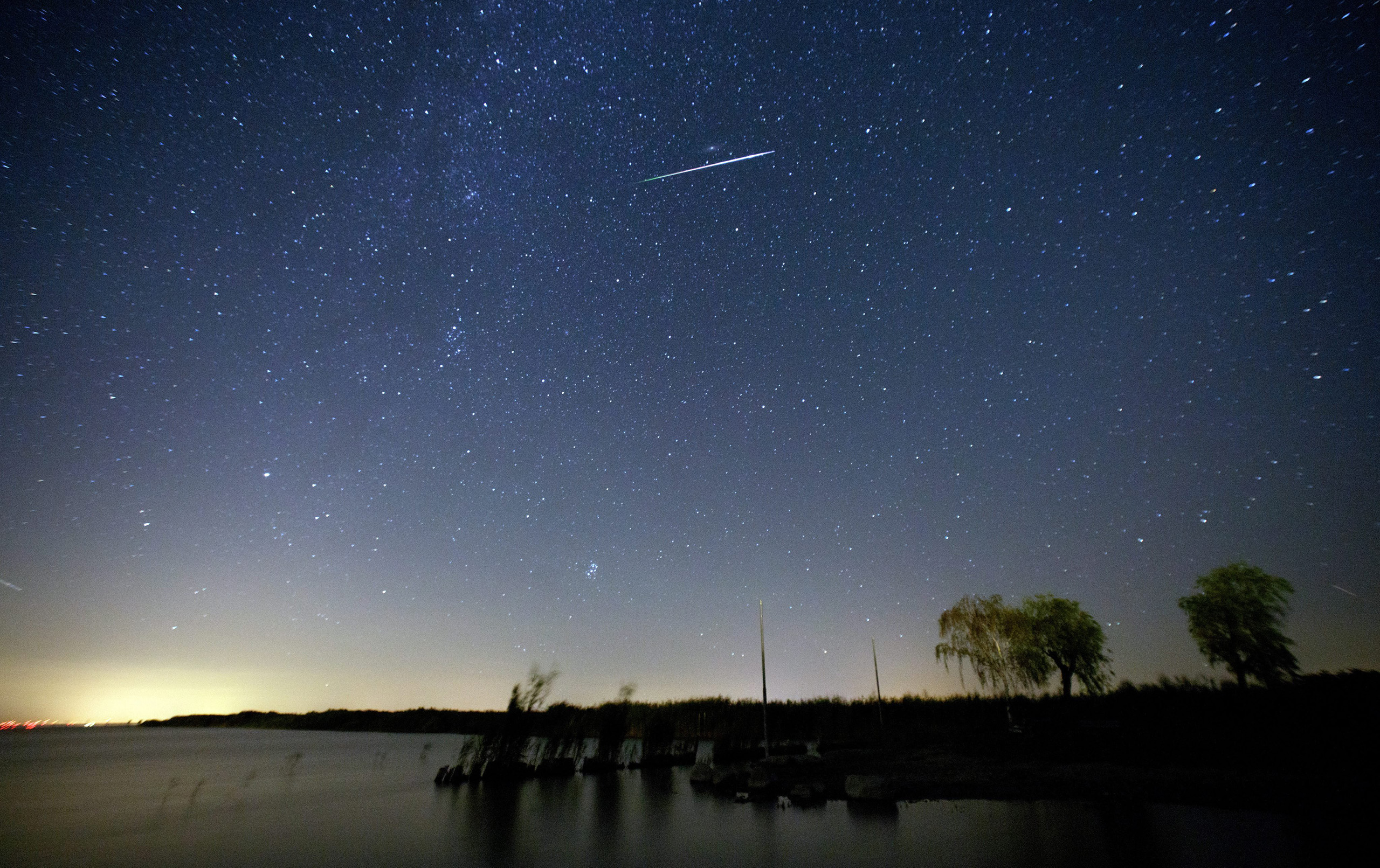 A meteor moving past stars in the night sky over lake Neusiedlersee near Moerbisch am See, around 70km southeast of Vienna, Austria, early Aug. 12, 2016.