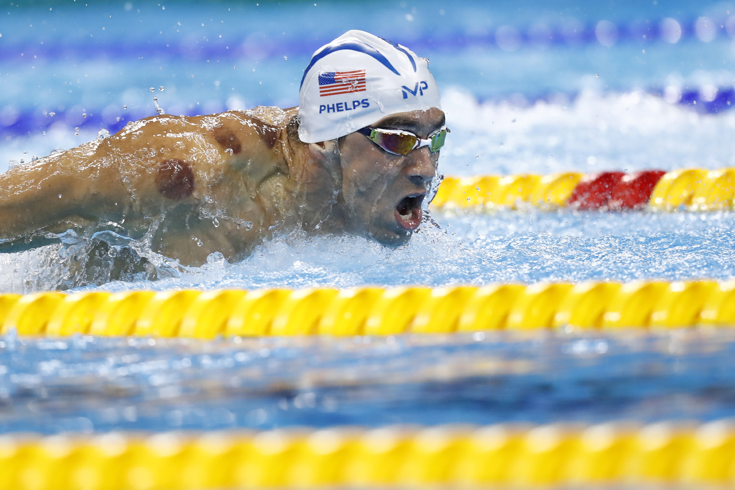 Michael Phelps competes in a men's 200-m butterfly heat during the swimming event at the Rio 2016 Olympic Games at the Olympic Aquatics Stadium in Rio de Janeiro on Aug. 8, 2016