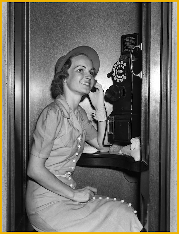 Woman using a pay phone circa 1930s