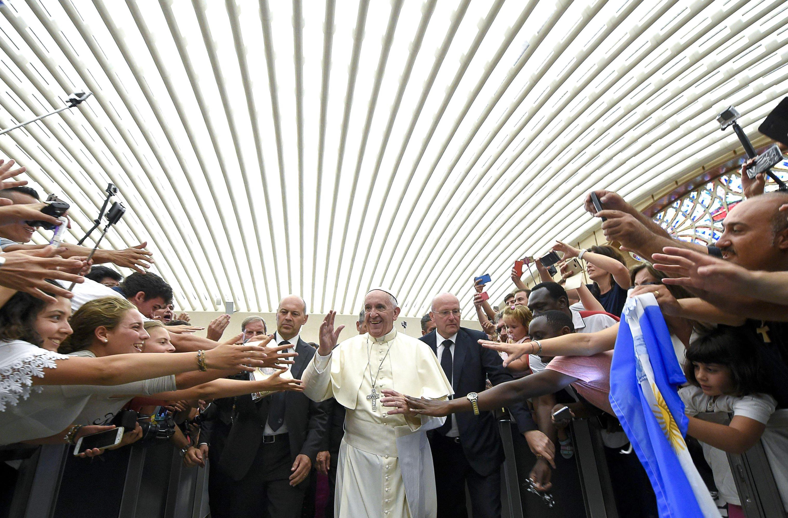 Pope Francis greeting faithful during his weekly general audience, in the Paul VI Hall, Vatican City, on Aug. 03, 2016.