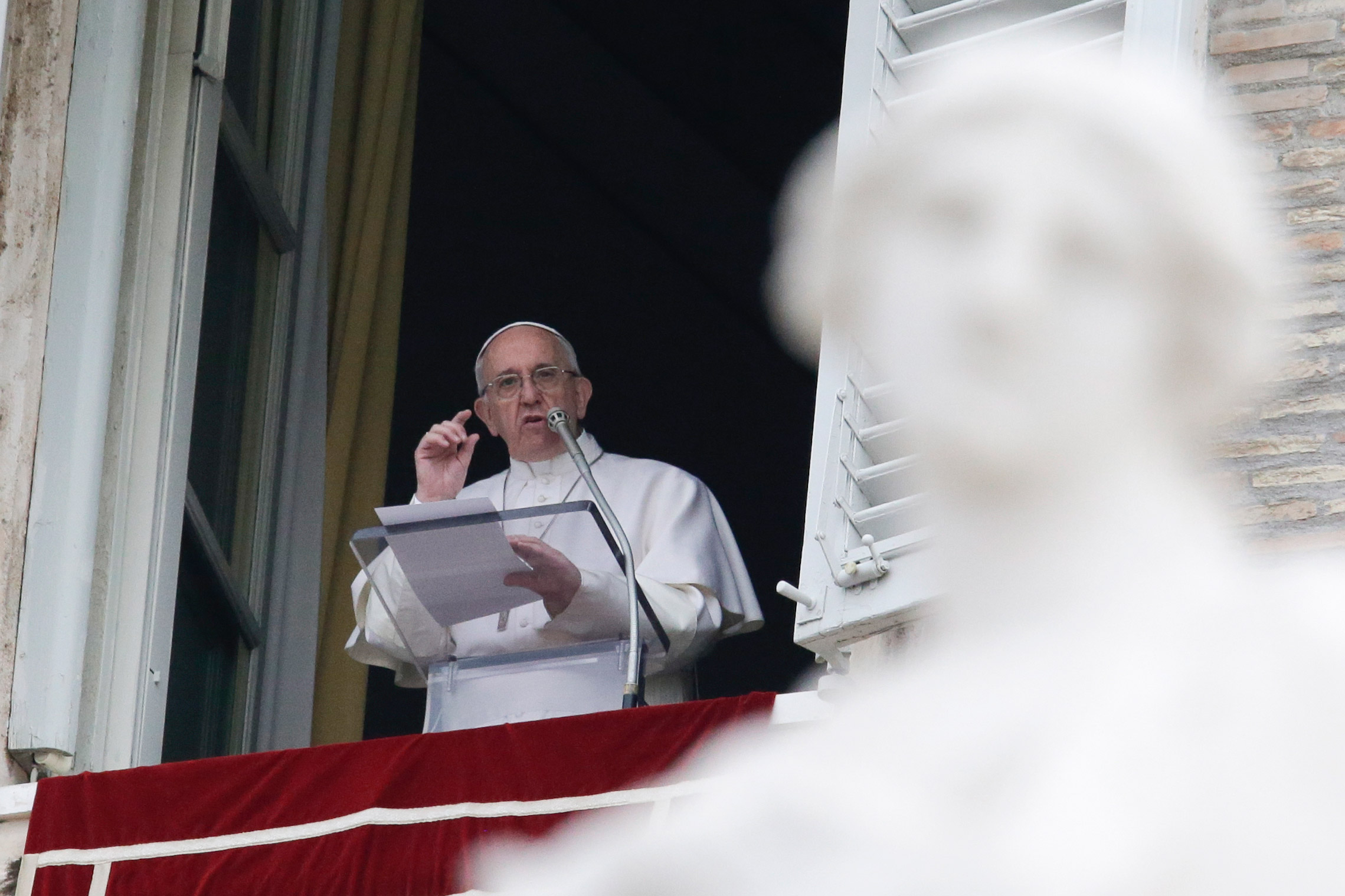 Pope Francis delivers the Regina Coeli prayer from his studio's window overlooking St. Peter's Square at the Vatican on Mar. 28, 2016.