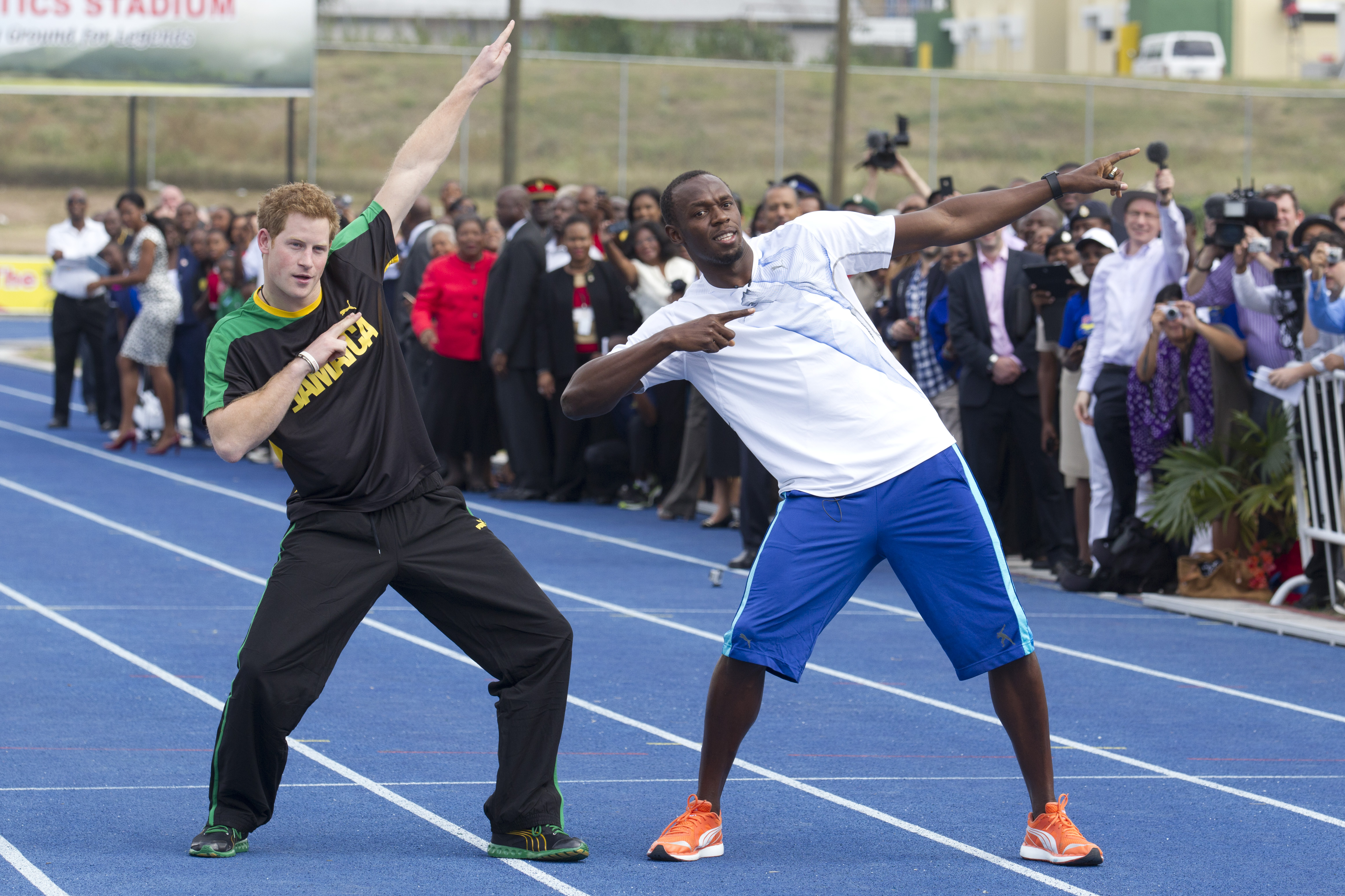 Prince Harry and Usain Bolt in Kingston, Jamaica in 2012.