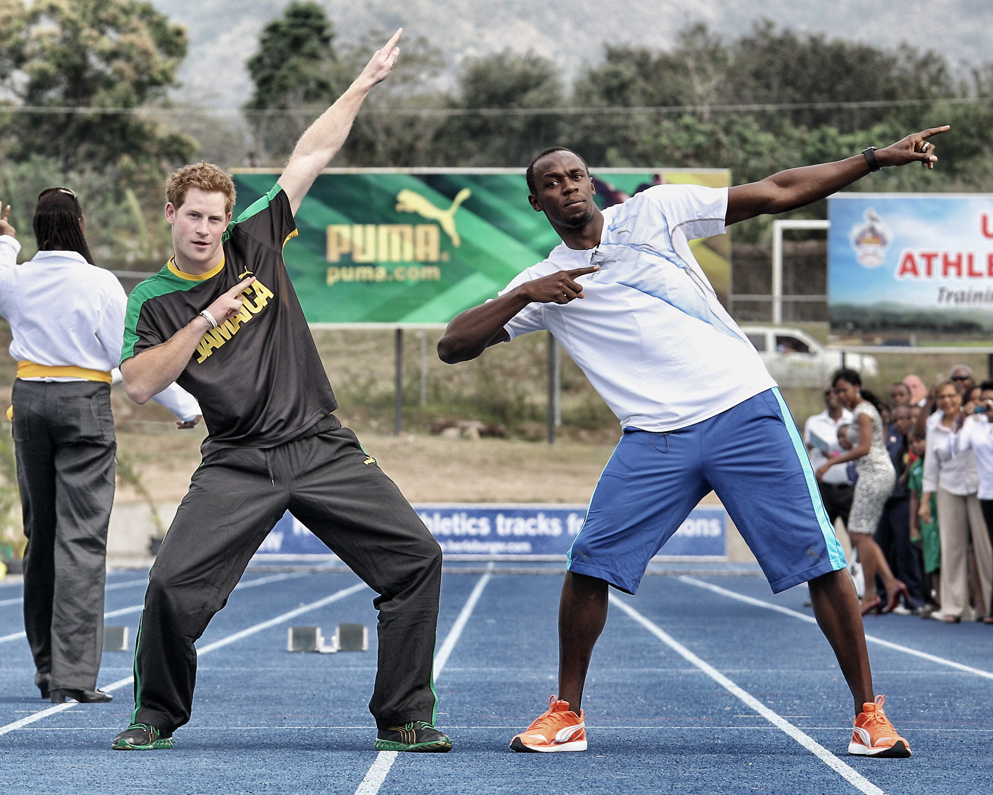 Prince Harry races Usain Bolt at the Usain Bolt Track at the University of the West Indies in Kingston, Jamaica on March 6, 2012.