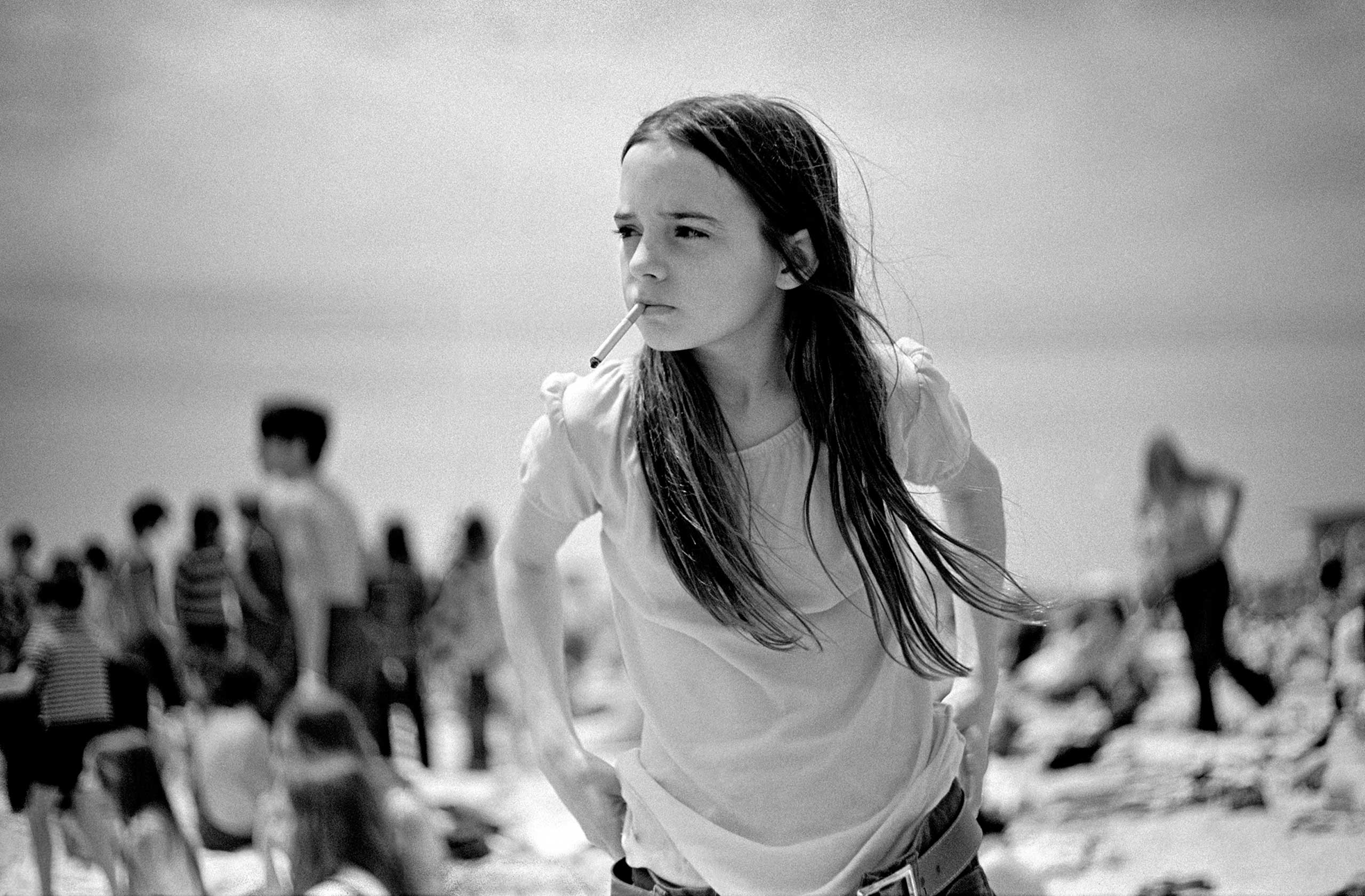Priscilla, 1969. When my wife and I first moved to Long Island, a friend suggested I visit Jones Beach because of my love of                               photographing people.  The ever changing variety of people, faces, bodies, and expressions, decade after decade,                               always fascinates me. Priscilla seems to embody strength and determination and the quality of a timeless image.