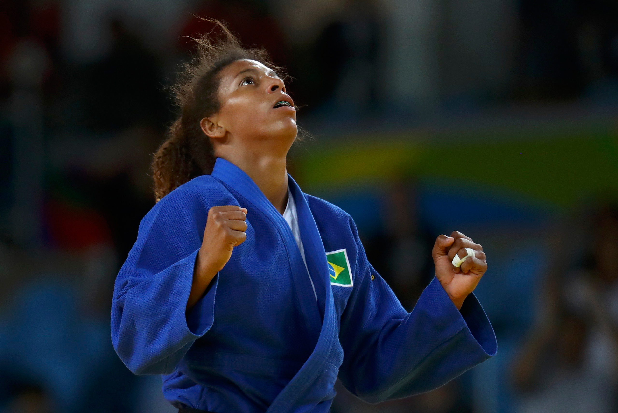 Brazil's Rafaela Silva celebrates after winning the gold medal of the women's 57-kg judo competition at the 2016 Summer Olympics in Rio de Janeiro on Aug. 8, 2016.