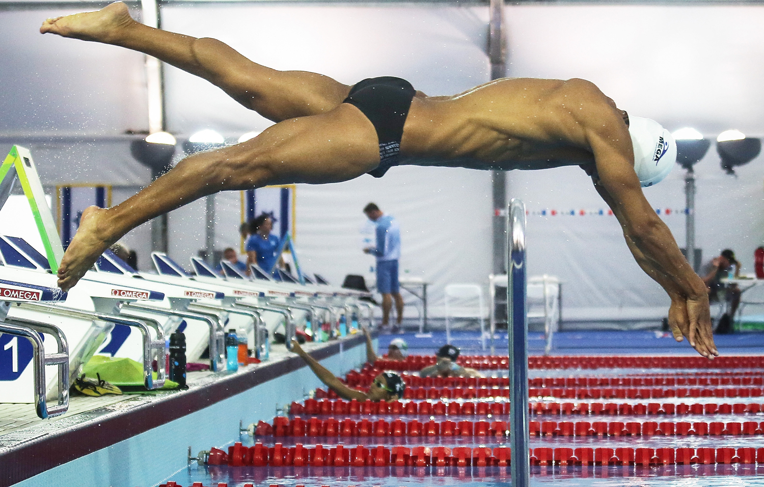 Rami Anis, an Olympic refugee team swimmer from Syria, dives while training at the Olympic Aquatics Stadium ahead of the opening ceremonies in Rio de Janeiro on July 28, 2016.